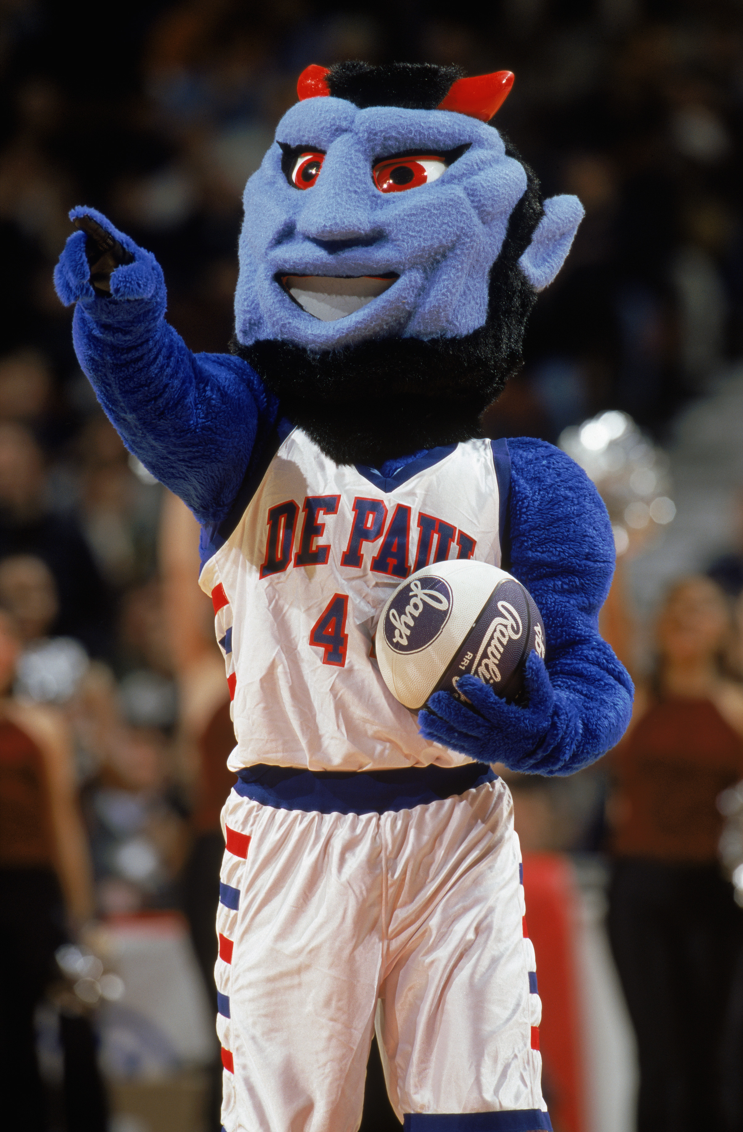 CHICAGO - JANUARY 26:  Dibs, the Demons? mascot entertains the crowd during the NCAA basketball game between the DePaul Blue Demons and the Florida Gators at the United Center on January 26, 2000 in Chicago, Illinois.  The Blue Demons defeated the Gators