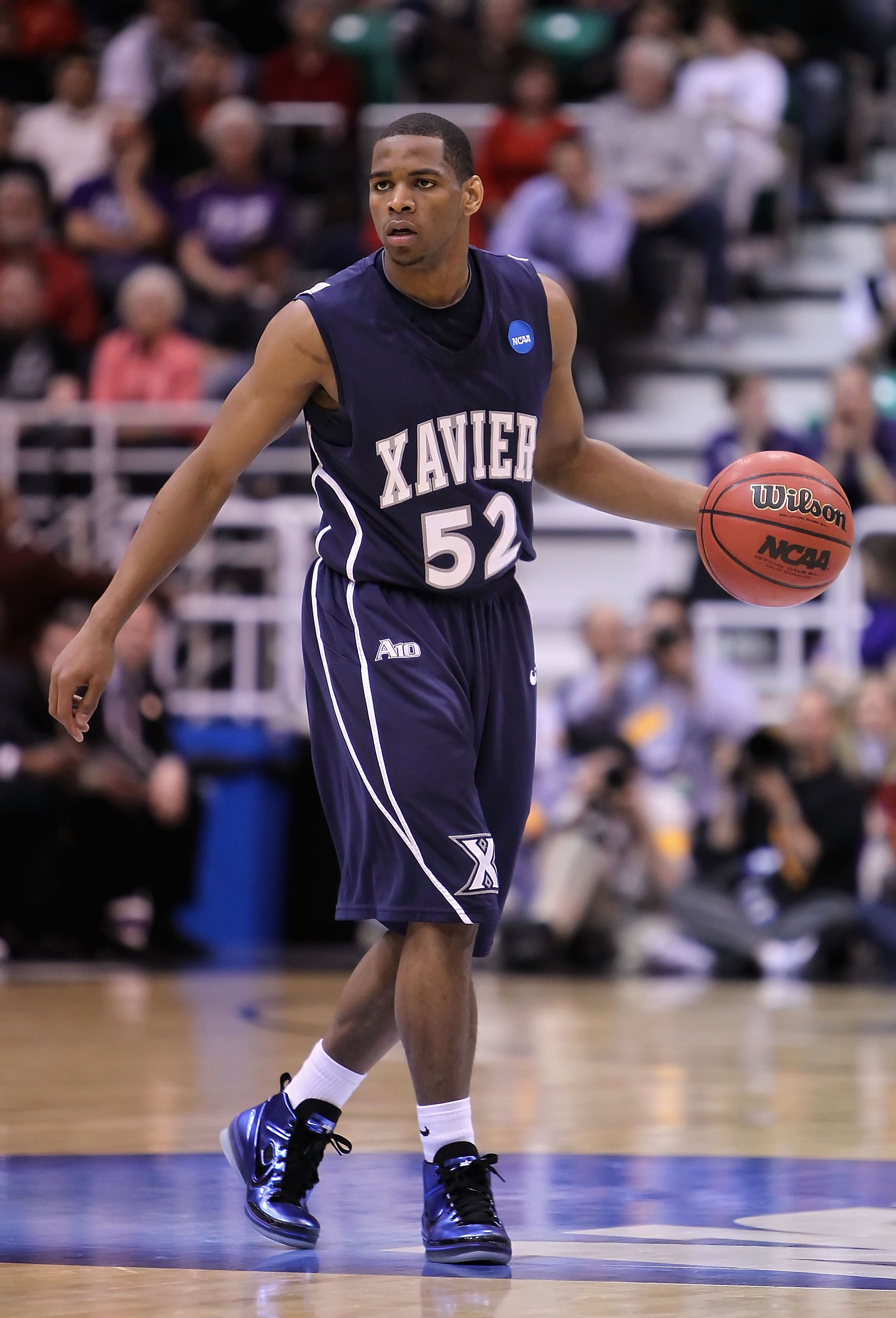 SALT LAKE CITY - MARCH 25:  Terrell Holloway #52 of the Xavier Musketeers handles the ball against the Kansas State Wildcats during the west regional semifinal of the 2010 NCAA men's basketball tournament at the Energy Solutions Arena on March 25, 2010 in