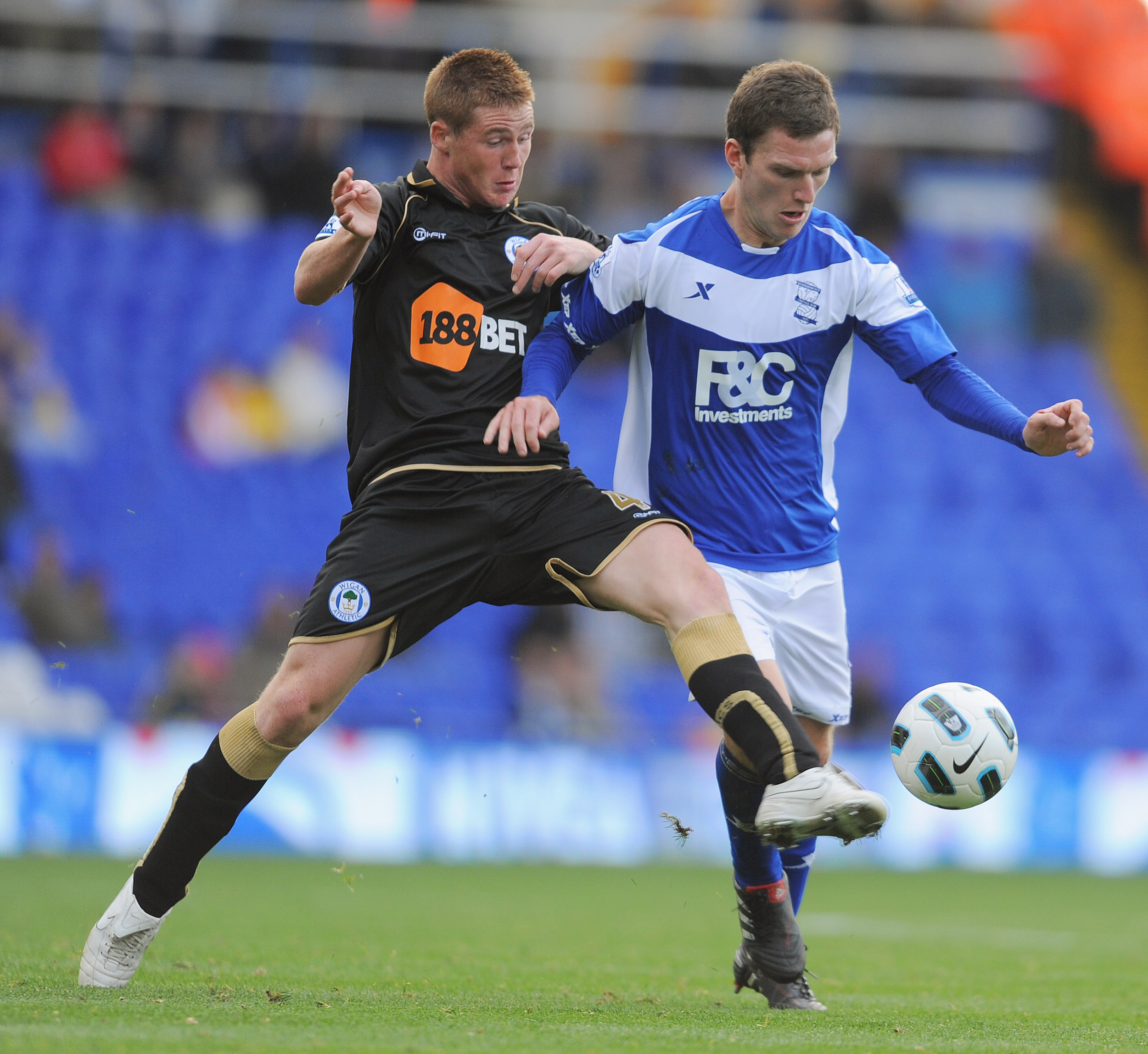 BIRMINGHAM, ENGLAND - SEPTEMBER 25:  Craig Gardner of Birmingham in action with James McCarthyi of Wigan during the Barclays Premier League match between Birmingham City and Wigan Athletic at St Andrews on September 25, 2010 in Birmingham, England.  (Phot