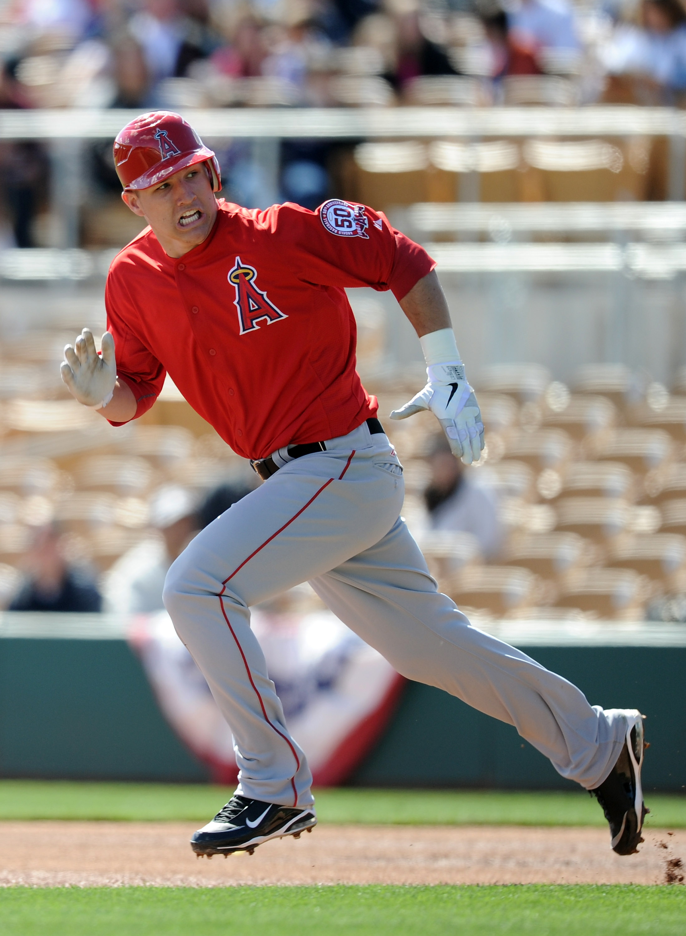 PHOENIX, AZ - FEBRUARY 27:  Mike Trout #90 of the Los Angeles Angels of Anaheim runs to second base against the Los Angeles Dodgers during spring training at Camelback Ranch on February 27, 2011 in Phoenix, Arizona.  (Photo by Harry How/Getty Images)