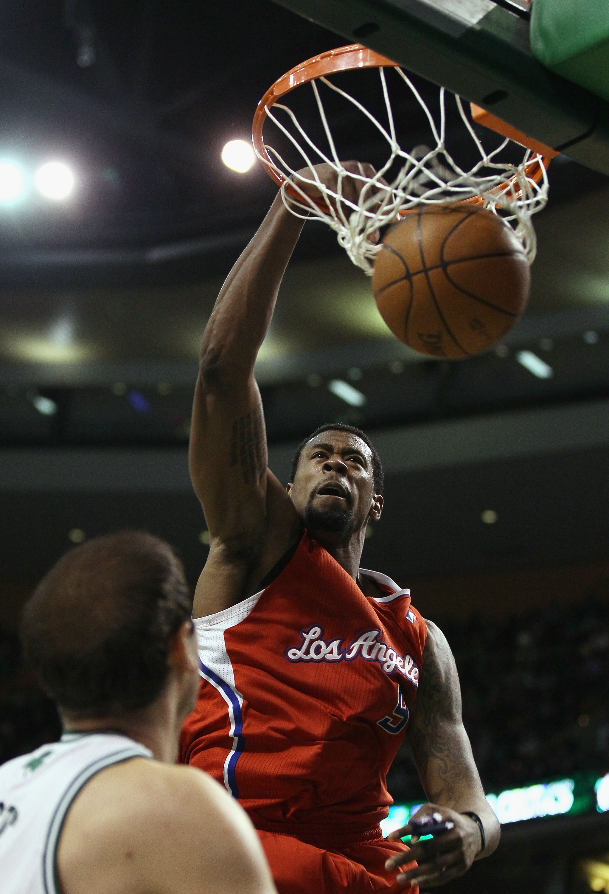 BOSTON, MA - MARCH 09:  DeAndre Jordan #9 of the Los Angeles Clippers dunks the ball as Nenad Krstic #4 of the Boston Celtics defends on March 9, 2011 at the TD Garden in Boston, Massachusetts. The Los Angeles Clippers defeated the Boston Celtics 108-103.