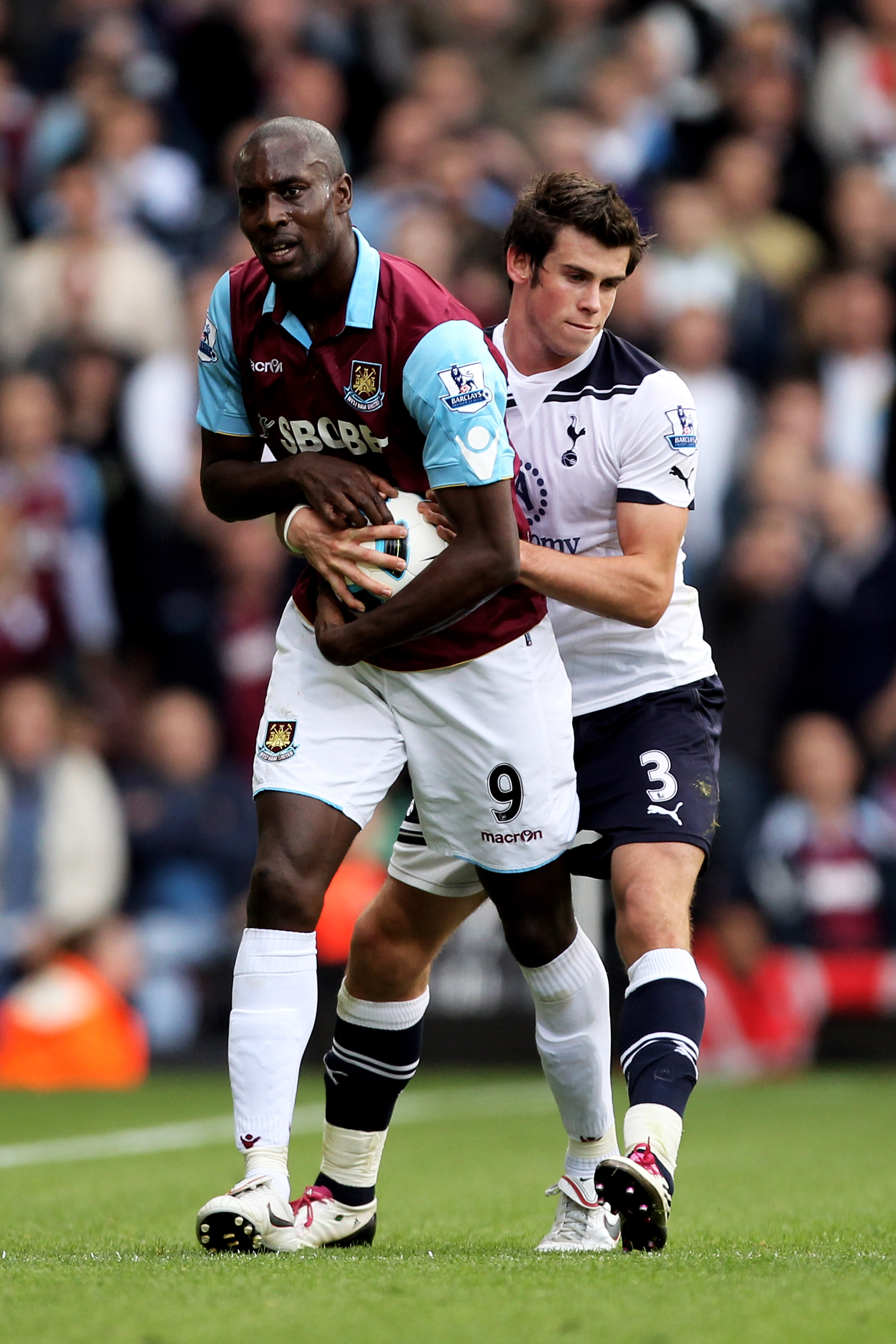 LONDON, ENGLAND - SEPTEMBER 25:  Carlton Cole of West Ham refuses to give the ball to Gareth Bale of Spurs for a throw in late on during the Barclays Premier League match between West Ham United and Tottenham Hotspur at the Boleyn Ground on September 25,