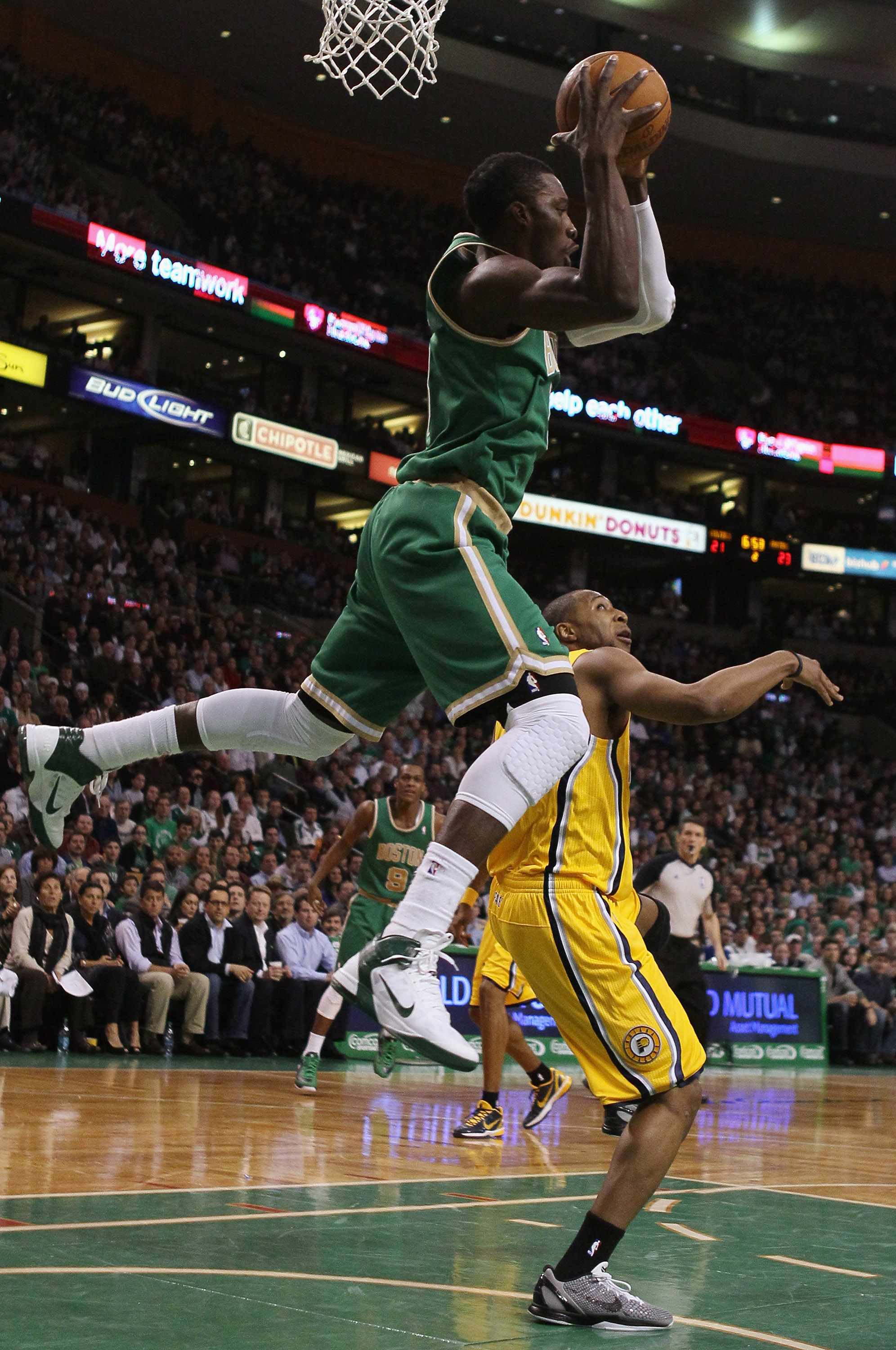 BOSTON, MA - MARCH 16:  Jeff Green #8 of the Boston Celtics grabs a pass as A.J. Price #12 of the Indiana Pacers defends on March 16, 2011 at the TD Garden in Boston, Massachusetts.  NOTE TO USER: User expressly acknowledges and agrees that, by downloadin