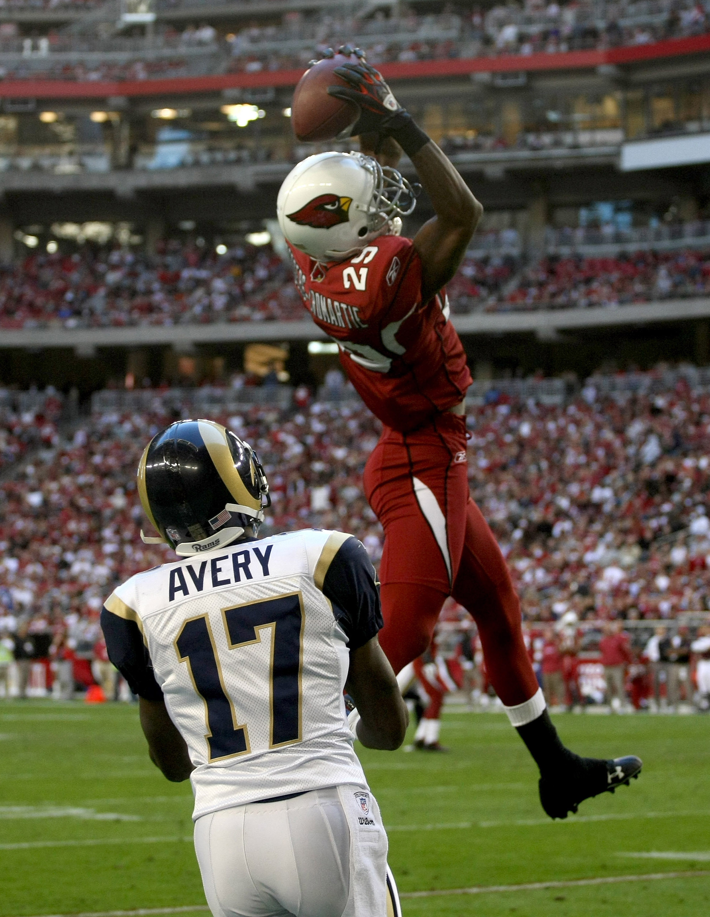 GLENDALE, AZ - DECEMBER 27:  Cornerback Dominique Rodgers-Cromartie #29 of the Arizona Cardinals jumps to intercept a pass over wide receiver Donnie Avery #19 of the St. Louis Rams in the fourth quarter on December 27, 2009 at University of Phoenix Stadiu