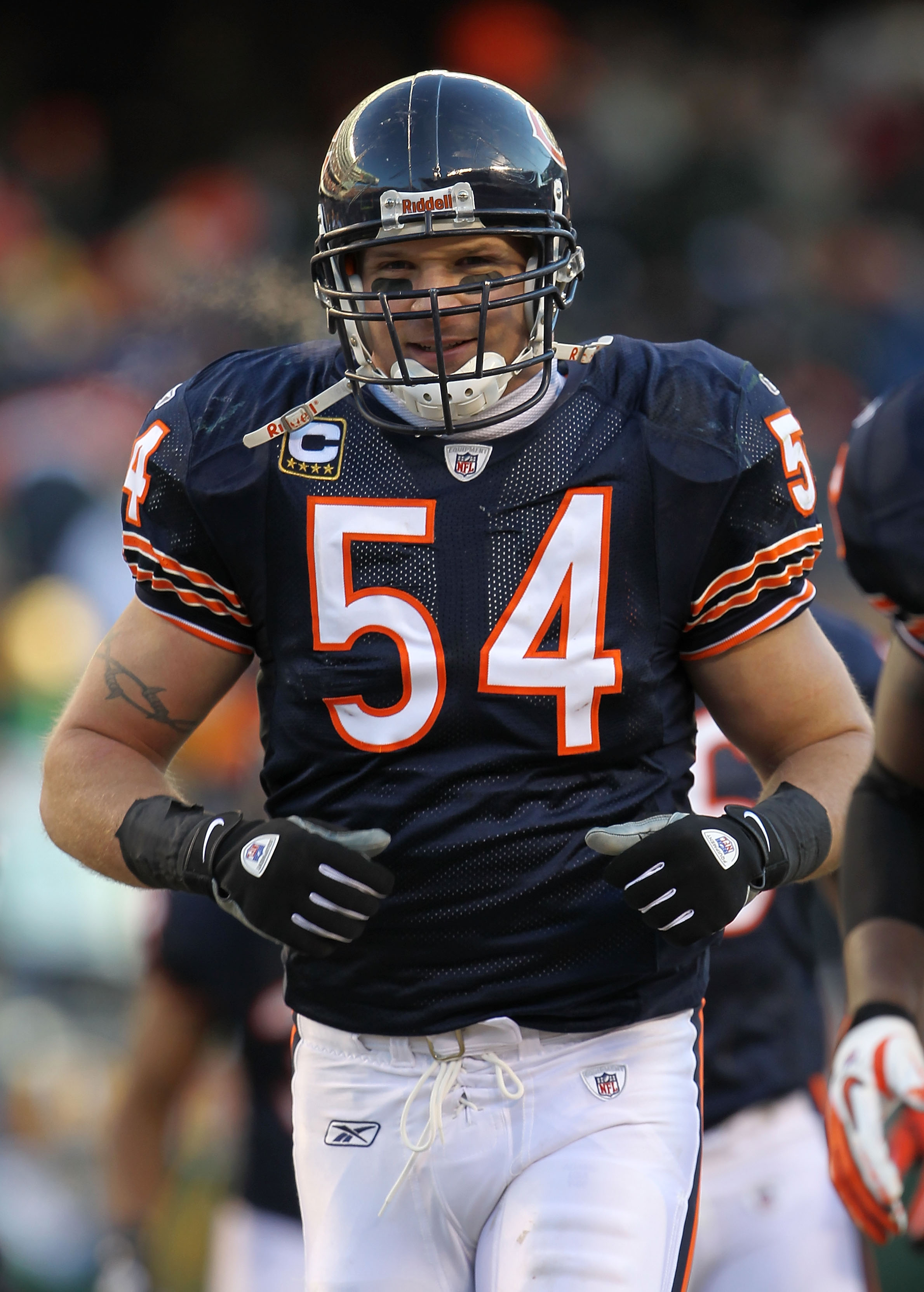 CHICAGO, IL - JANUARY 23:  Brian Urlacher #54 of the Chicago Bears smiles while taking on the Green Bay Packers in the NFC Championship Game at Soldier Field on January 23, 2011 in Chicago, Illinois.  (Photo by Jamie Squire/Getty Images)