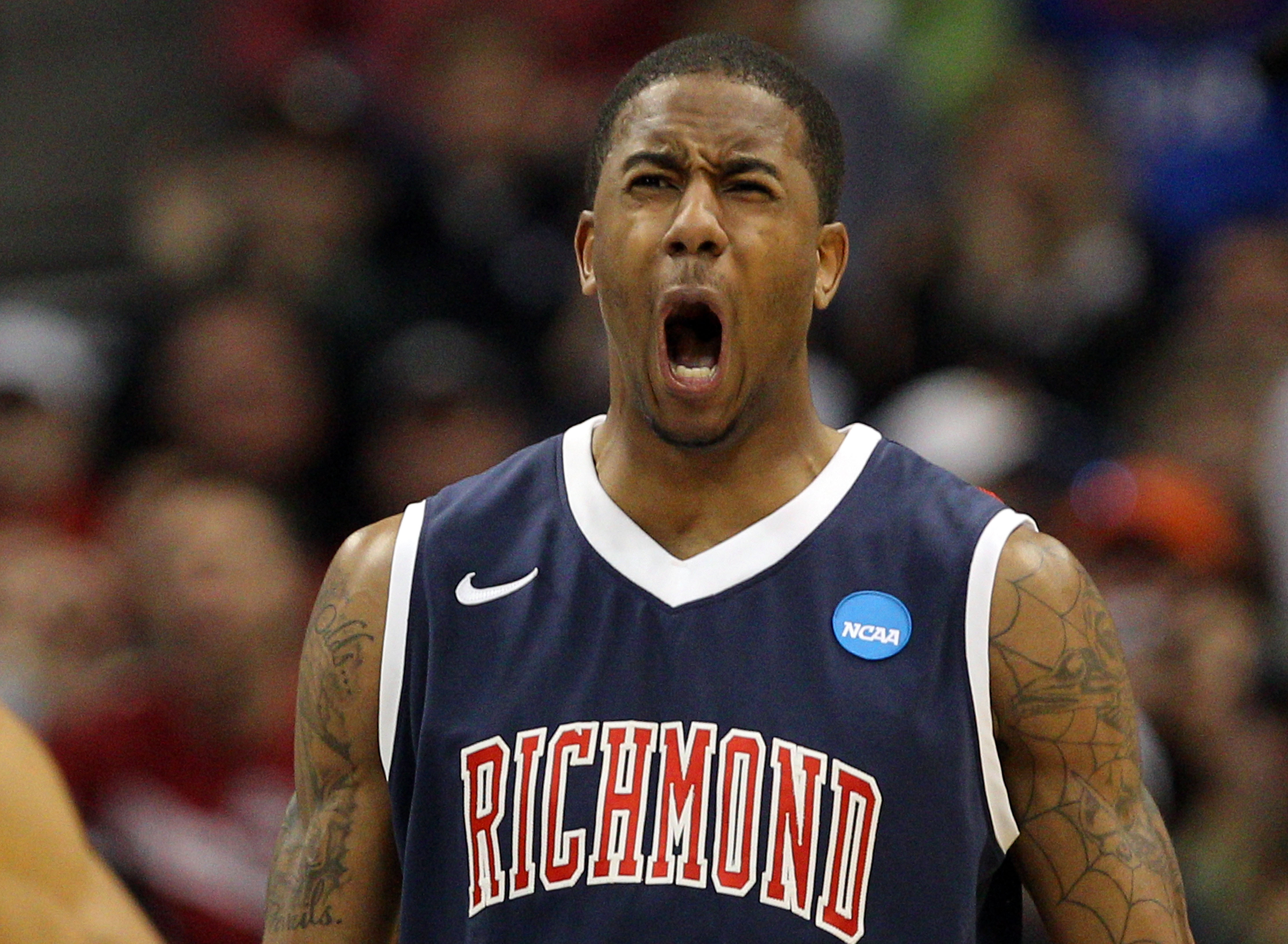 DENVER, CO - MARCH 17:  Darrius Garrett #1 of the Richmond Spiders reacts after a play against the Vanderbilt Commodores during the second round of the 2011 NCAA men's basketball tournament at Pepsi Center on March 17, 2011 in Denver, Colorado.  (Photo by