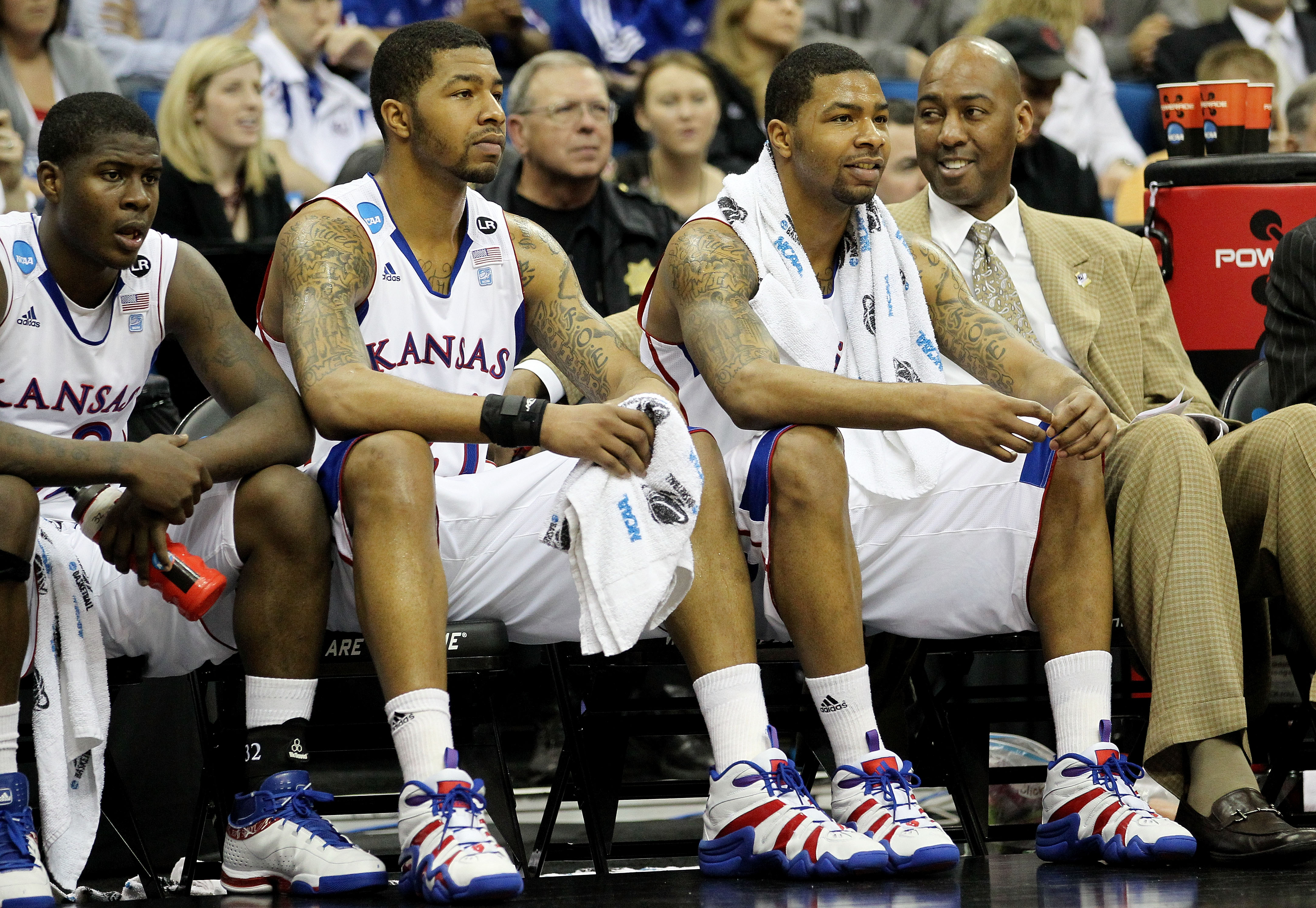 TULSA, OK - MARCH 18:  (2nd and 3rd from L) Markieff Morris #21 and Marcus Morris #22 of the Kansas Jayhawks sit on the bench during their second round game against the Boston University Terriers in the 2011 NCAA men's basketball tournament at BOK Center