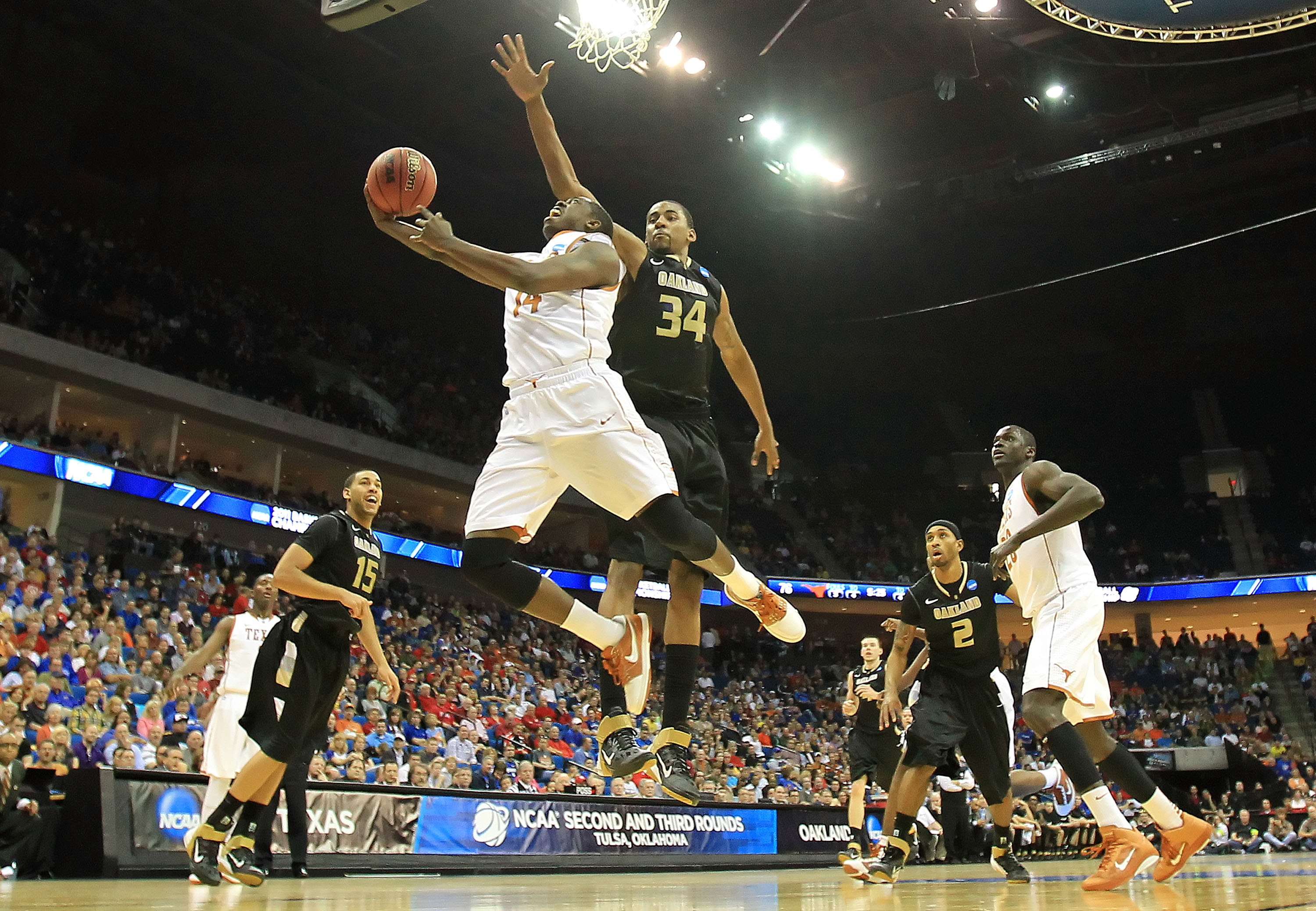 TULSA, OK - MARCH 18:  J'Covan Brown #14 of the Texas Longhorns goes up for a shot against Keith Benson #34 of the Oakland Golden Grizzlies during the second round of the 2011 NCAA men's basketball tournament at BOK Center on March 18, 2011 in Tulsa, Okla