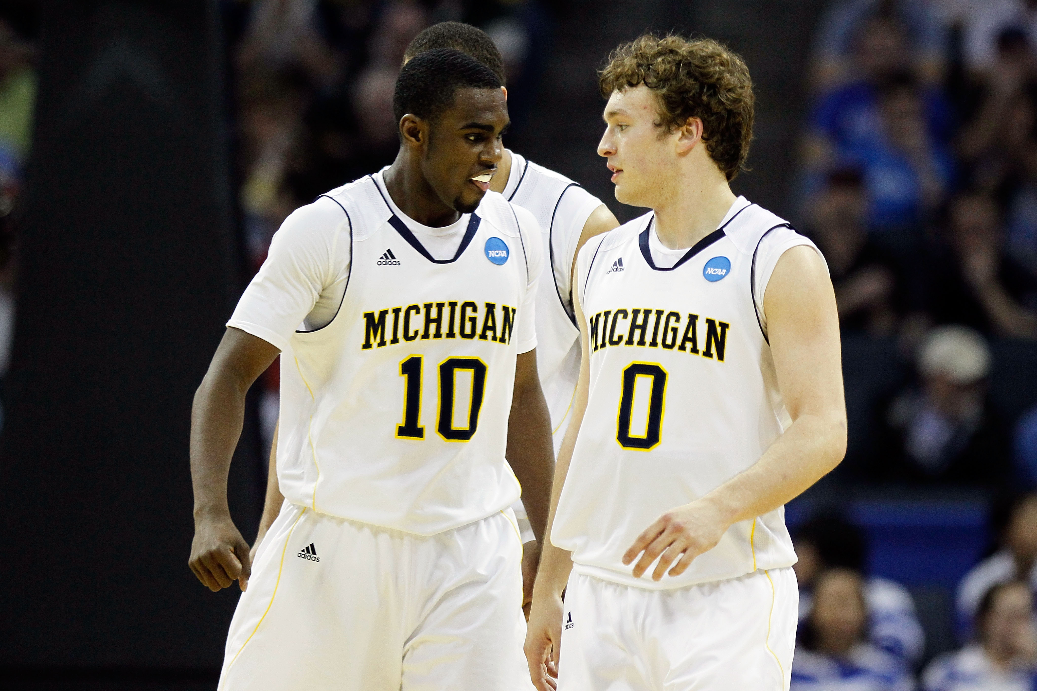 CHARLOTTE, NC - MARCH 18:  Tim Hardaway Jr. #10 and Zack Novak #0 of the Michigan Wolverines react in the second half while taking on the Tennessee Volunteers during the second round of the 2011 NCAA men's basketball tournament at Time Warner Cable Arena