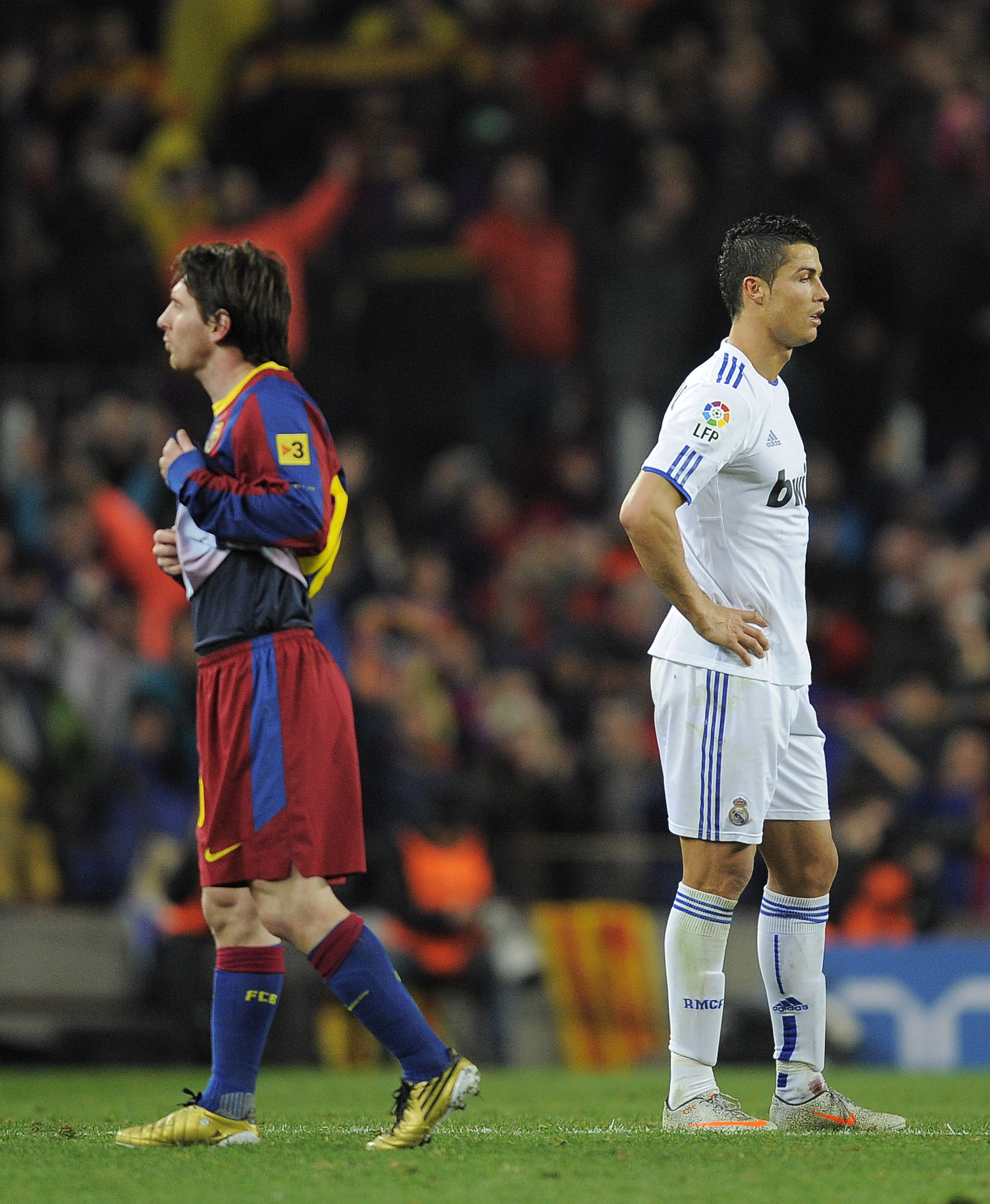 BARCELONA, SPAIN - NOVEMBER 29:  Cristiano Ronaldo of Real Madrid (R) and Lionel Messi of FC Barcelona look on during the La Liga match between Barcelona and Real Madrid at the Camp Nou Stadium on November 29, 2010 in Barcelona, Spain.  Barcelona won the
