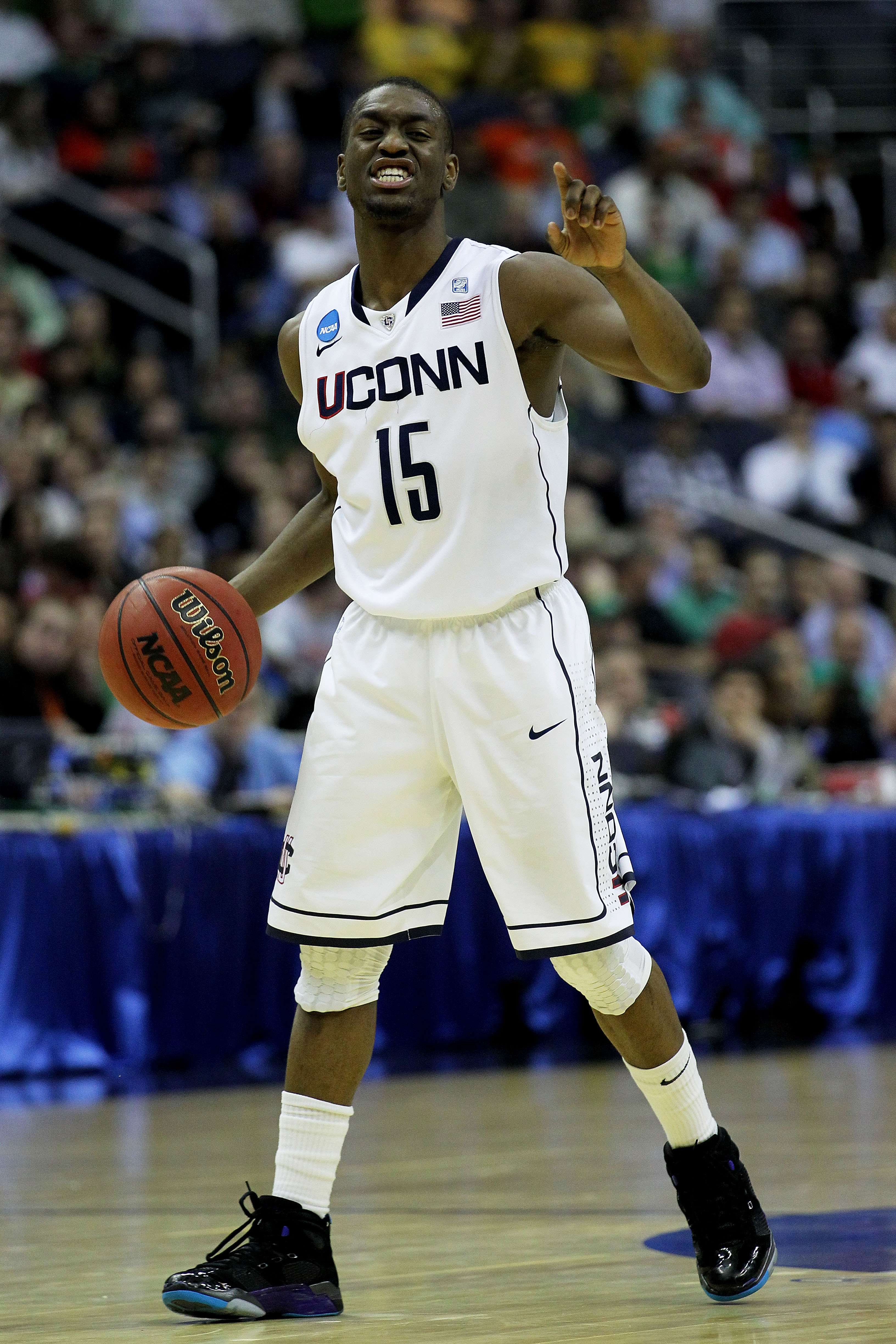 WASHINGTON - MARCH 17:  Kemba Walker #15 of the Connecticut Huskies calls a play against the Bucknell Bison during the second round of the 2011 NCAA men's basketball tournament at the Verizon Center on March 17, 2011 in Washington, DC.  (Photo by Nick Lah