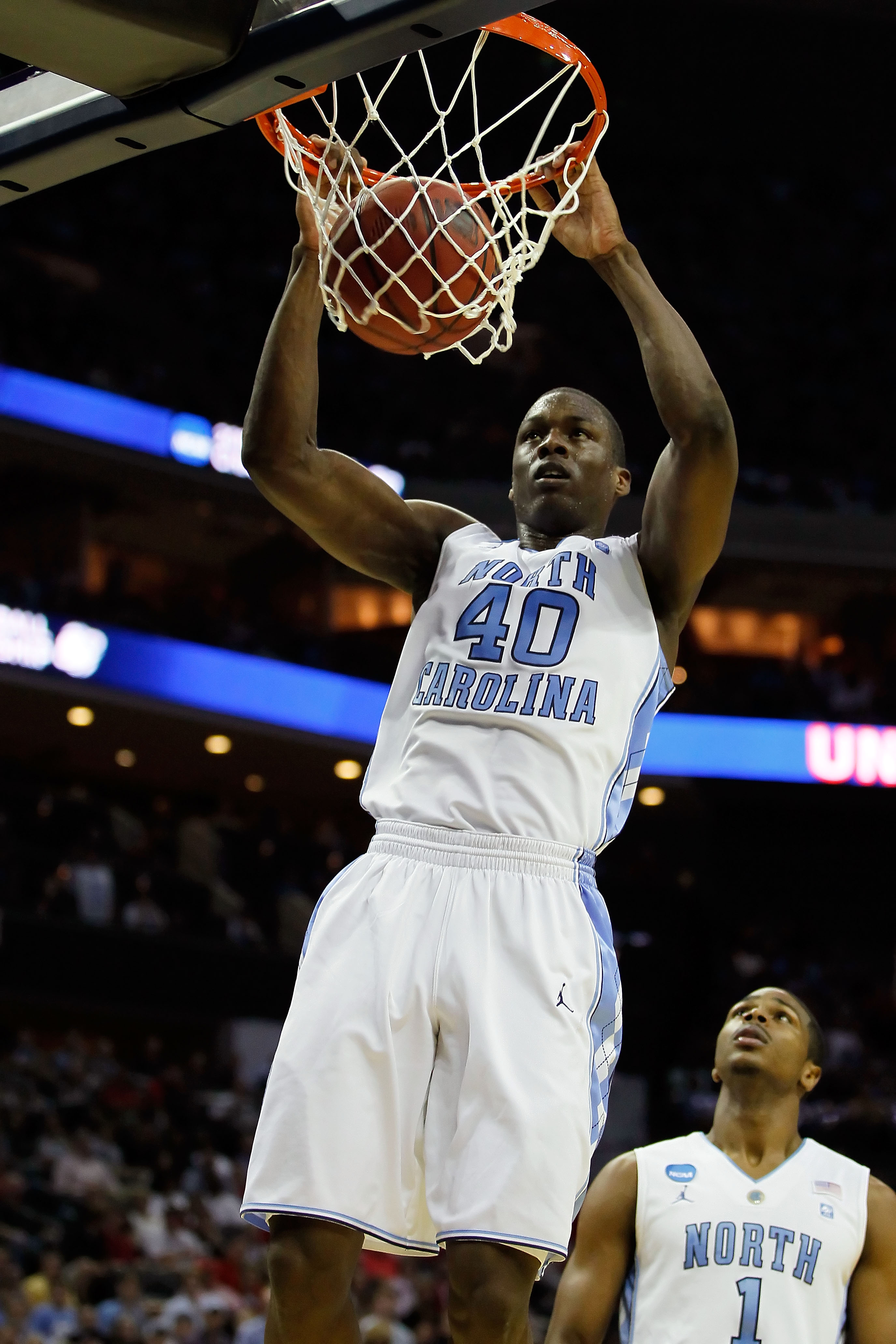 CHARLOTTE, NC - MARCH 18:  Harrison Barnes #40 of the North Carolina Tar Heels dunks the ball in the first half while taking on the Long Island Blackbirds during the second round of the 2011 NCAA men's basketball tournament at Time Warner Cable Arena on M