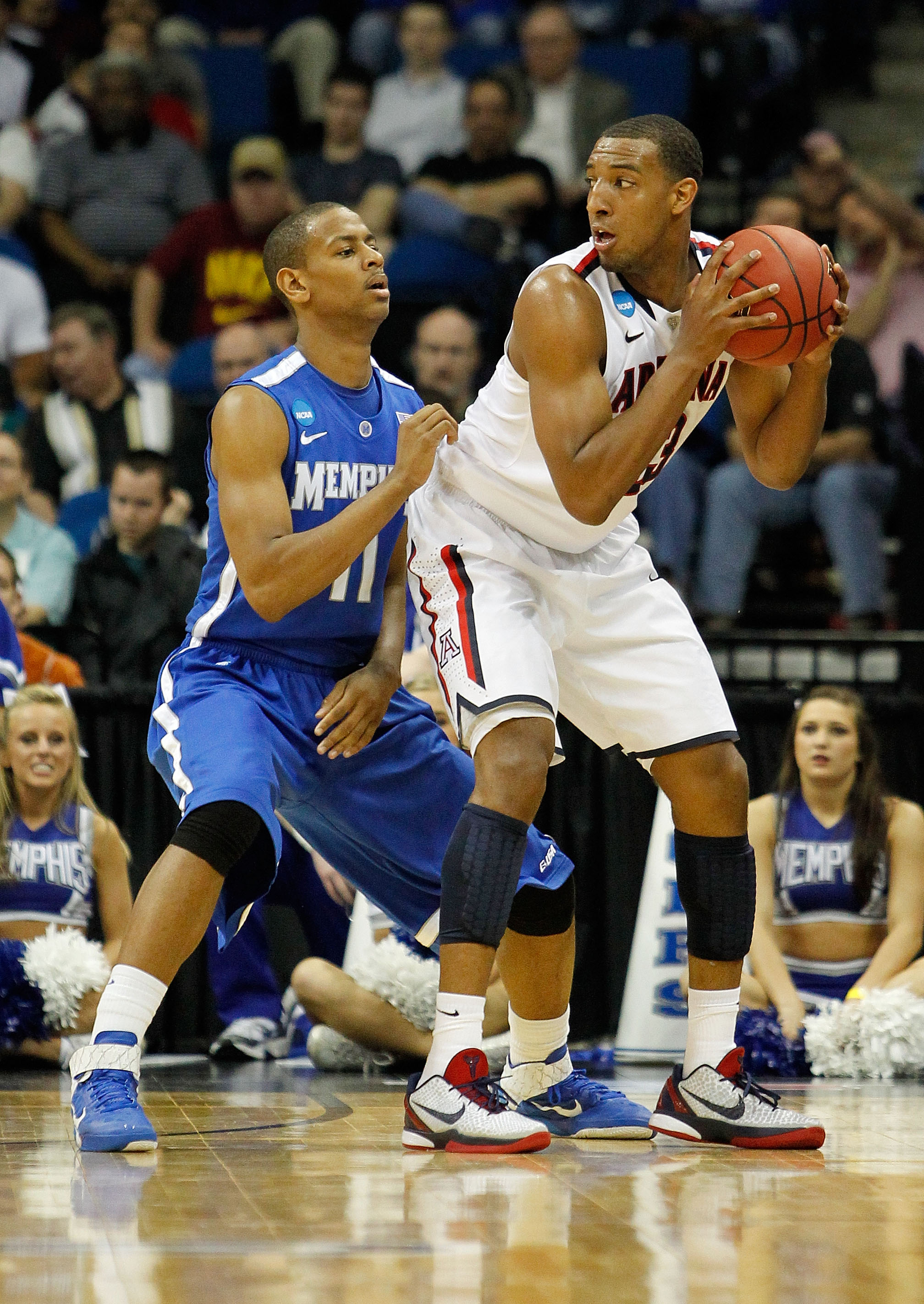 TULSA, OK - MARCH 18:  Derrick Williams #23 of the Arizona Wildcats looks to move the ball as Wesley Witherspoon #11 of the Memphis Tigers defends during the second round game of the 2011 NCAA men's basketball tournament at BOK Center on March 18, 2011 in