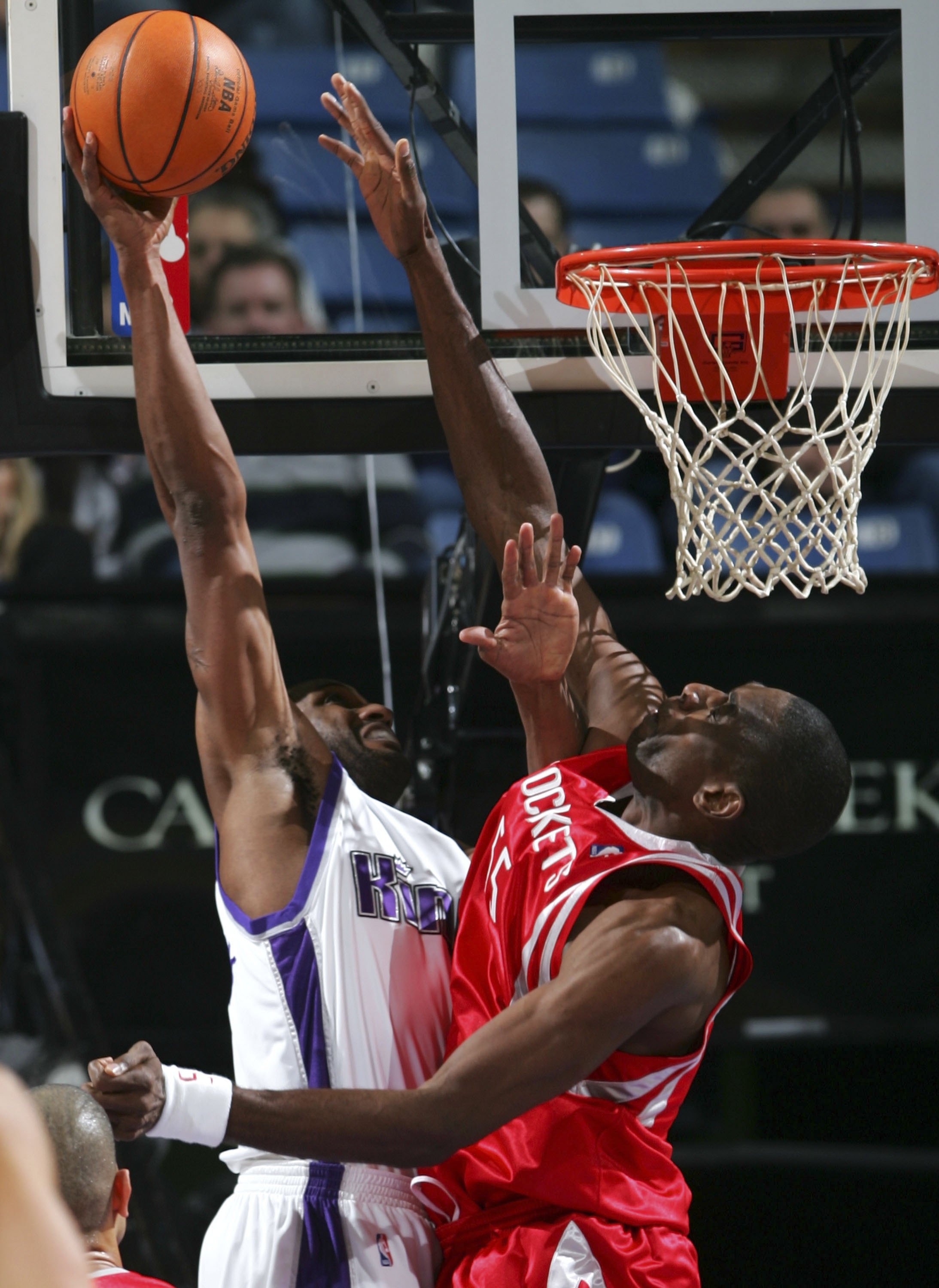 SACRAMENTO, CA - JANUARY 13:  Dikembe Mutombo #55 of the Houston Rockets tries to block a shot from Shareef Abdur-Rahim #3 of the Sacramento Kings during an NBA game at Arco Arena January 13, 2007 in Sacramento, California.  NOTE TO USER: User expressly a