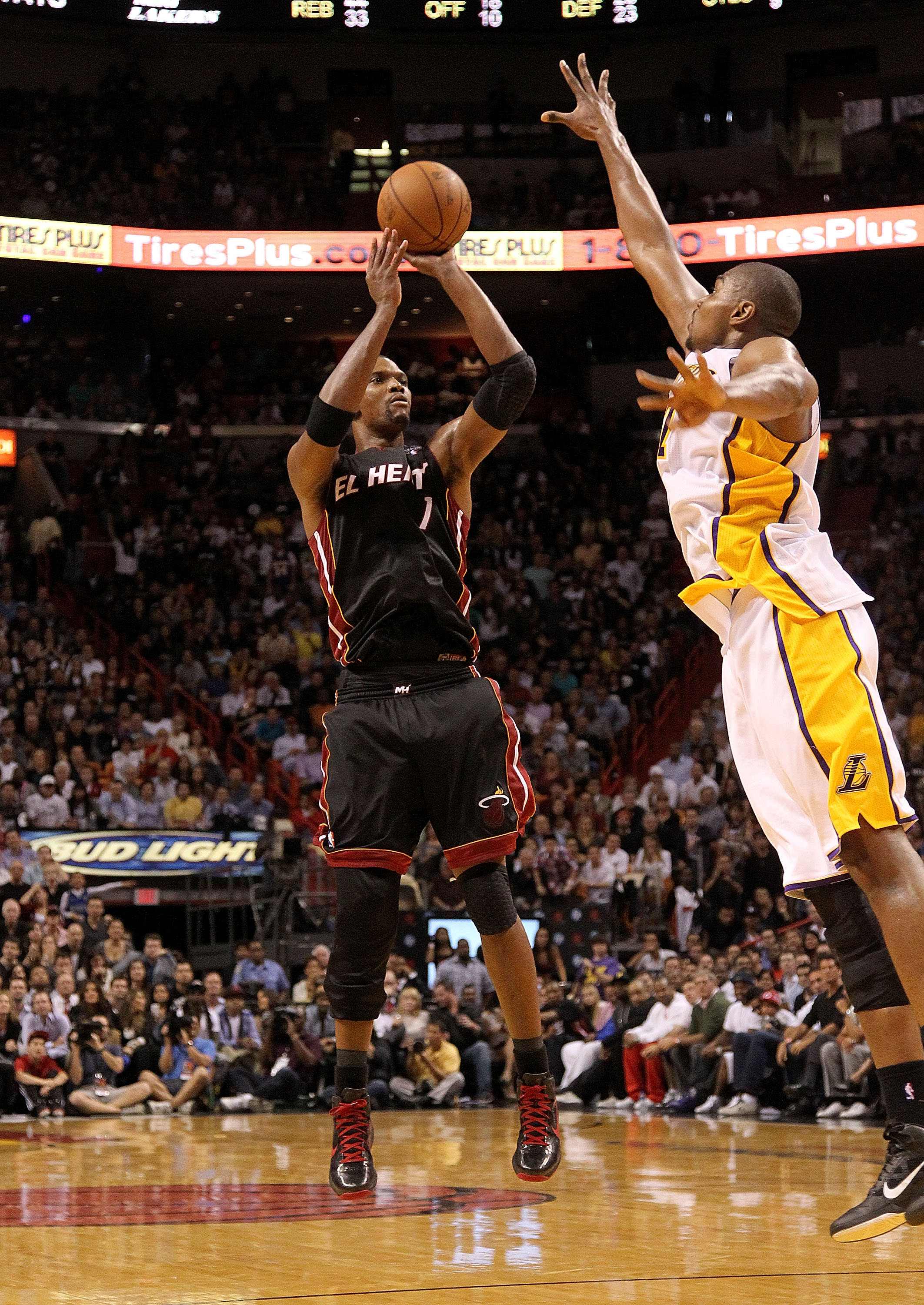 MIAMI, FL - MARCH 10:  Chris Bosh #1 of the Miami Heat shoots over Andrew Bynum #17 of  the Los Angeles Lakers  during a game at American Airlines Arena on March 10, 2011 in Miami, Florida. NOTE TO USER: User expressly acknowledges and agrees that, by dow