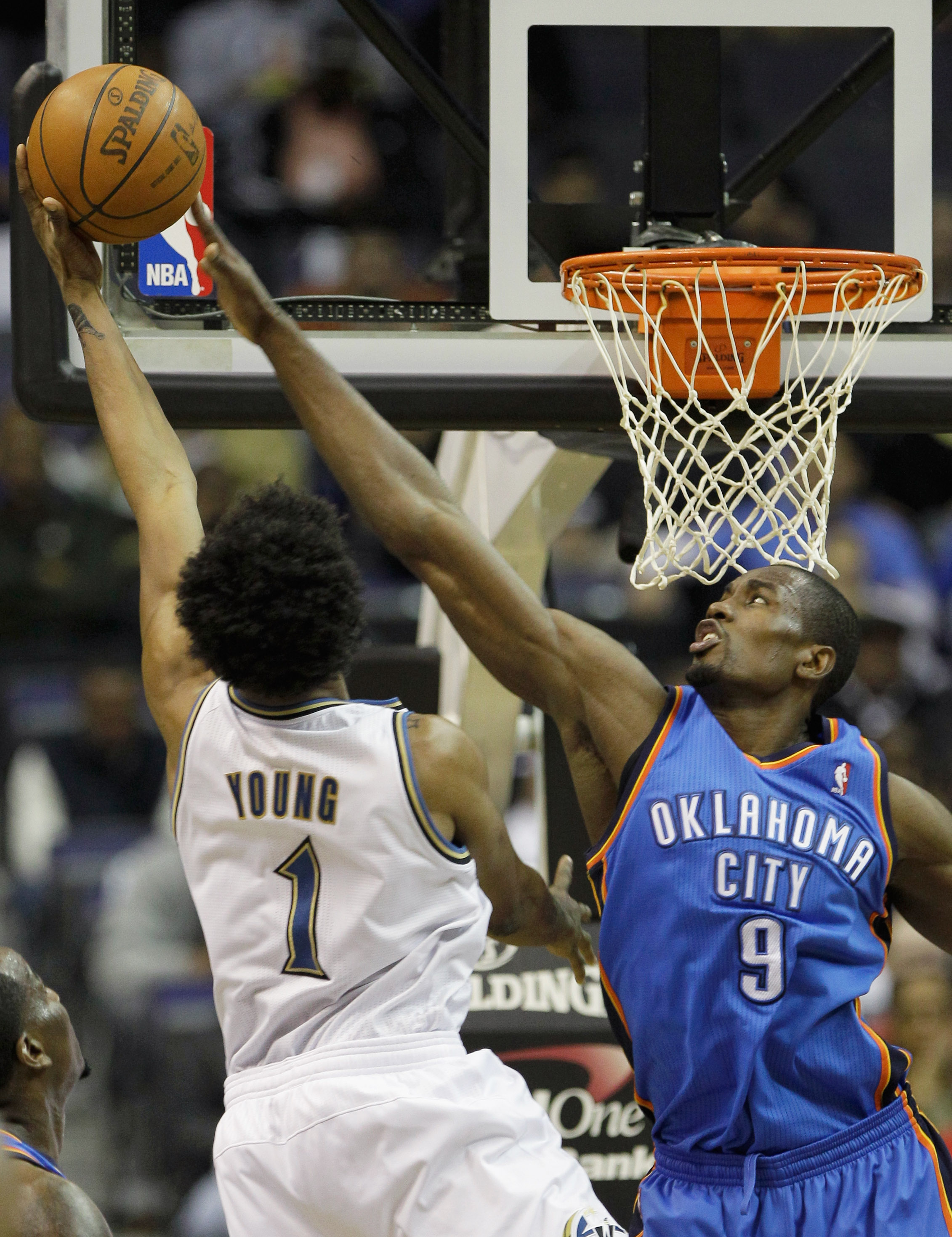 WASHINGTON, DC - MARCH 14: Serge Ibaka #9 of the Oklahoma City Thunder blocks a shot by Nick Young #1 of the Washington Wizards during the first half at the Verizon Center on March 14, 2011 in Washington, DC. NOTE TO USER: User expressly acknowledges and