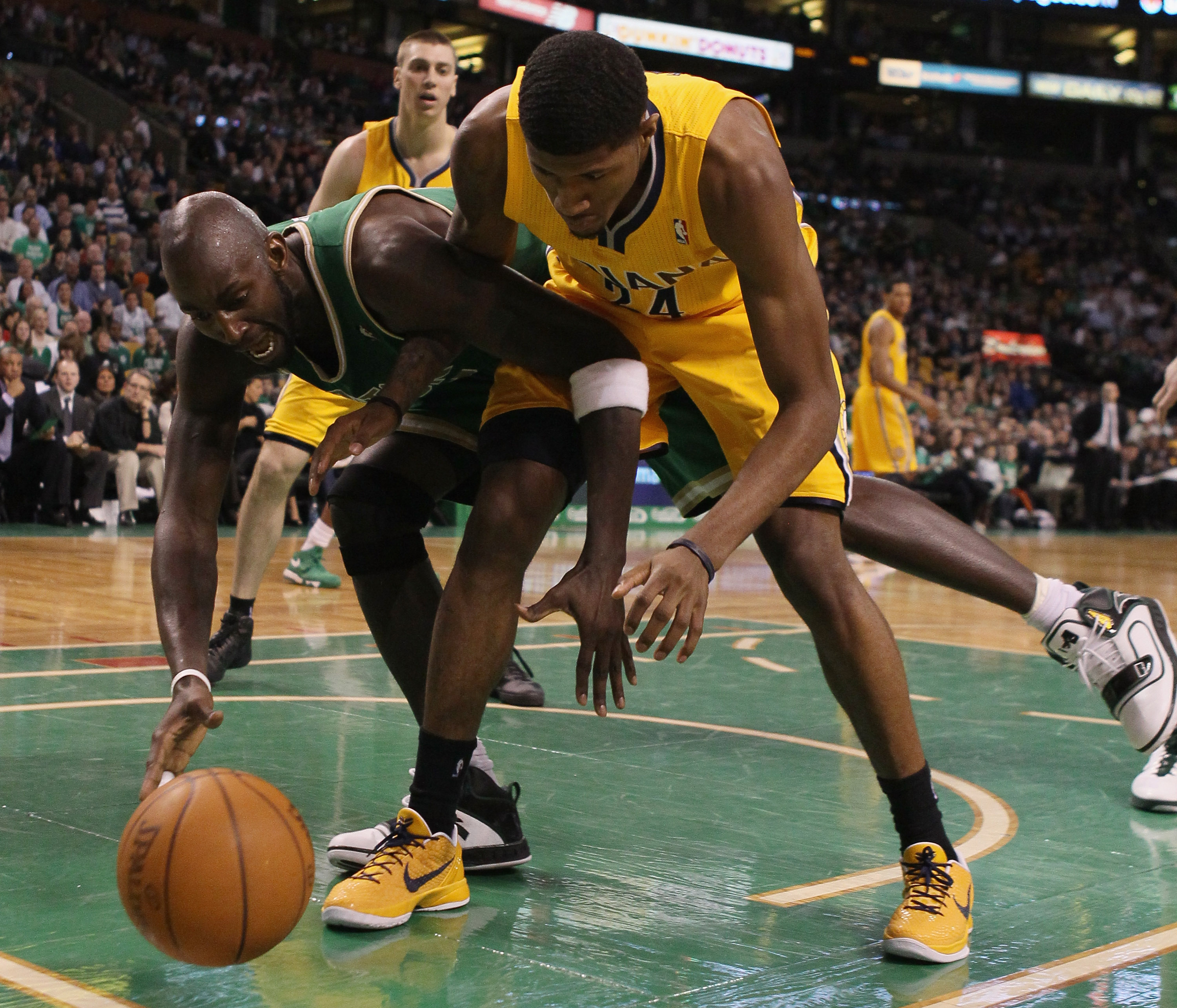 BOSTON, MA - MARCH 16:  Kevin Garnett #5 of the Boston Celtics and Paul George #24 of the Indiana Pacers go after the ball on March 16, 2011 at the TD Garden in Boston, Massachusetts. The Celtics defeated the Indiana Pacers 92-80. NOTE TO USER: User expre