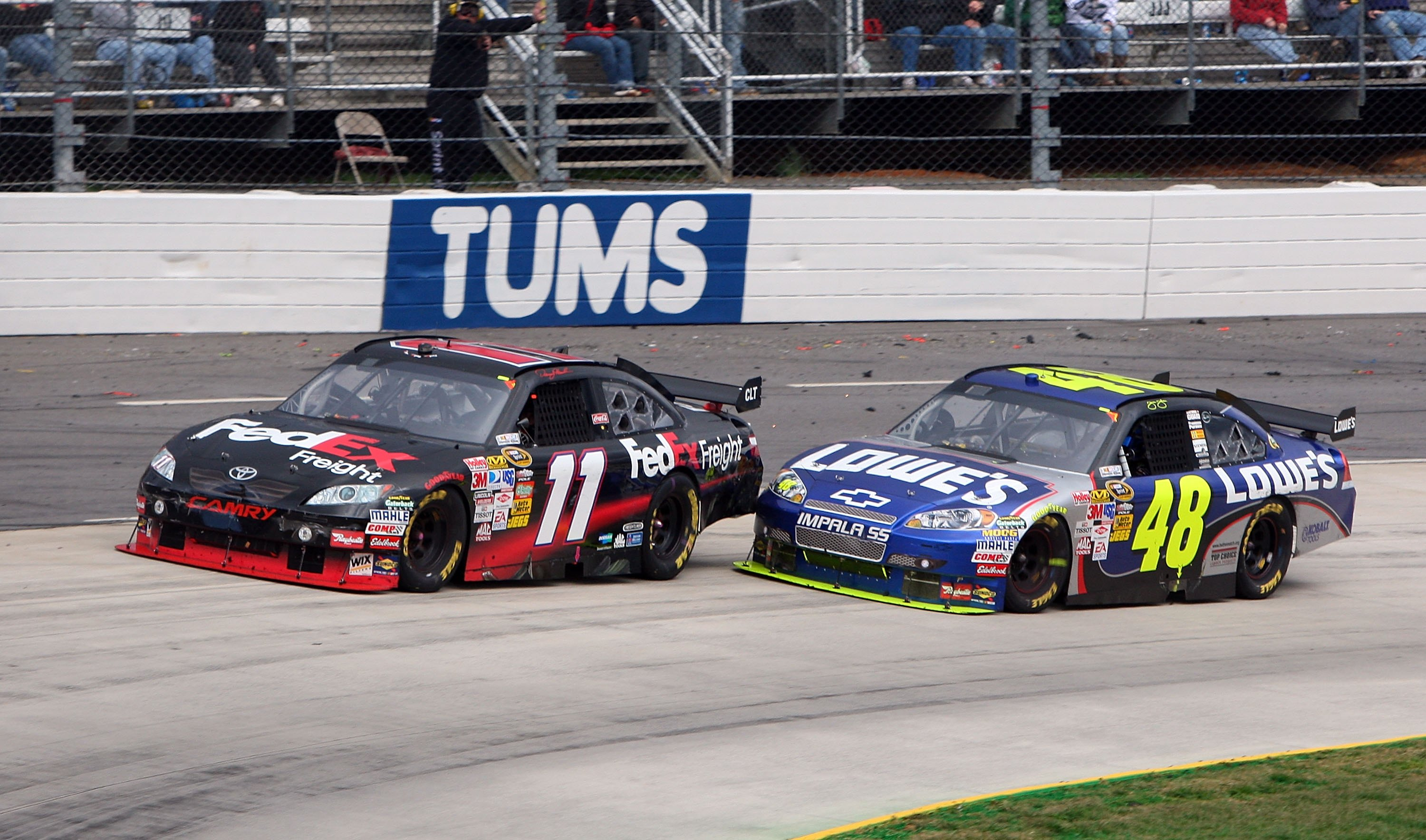Jimmie Johnson puts the bumper to Denny Hamlin.