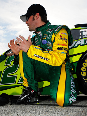FORT WORTH, TX - APRIL 09:  Paul Menard, driver of the #27 Quaker State/Menards Chevrolet, kneels on the grid prior to the start of the NASCAR Sprint Cup Series Samsung Mobile 500 at Texas Motor Speedway on April 9, 2011 in Fort Worth, Texas.  (Photo by J