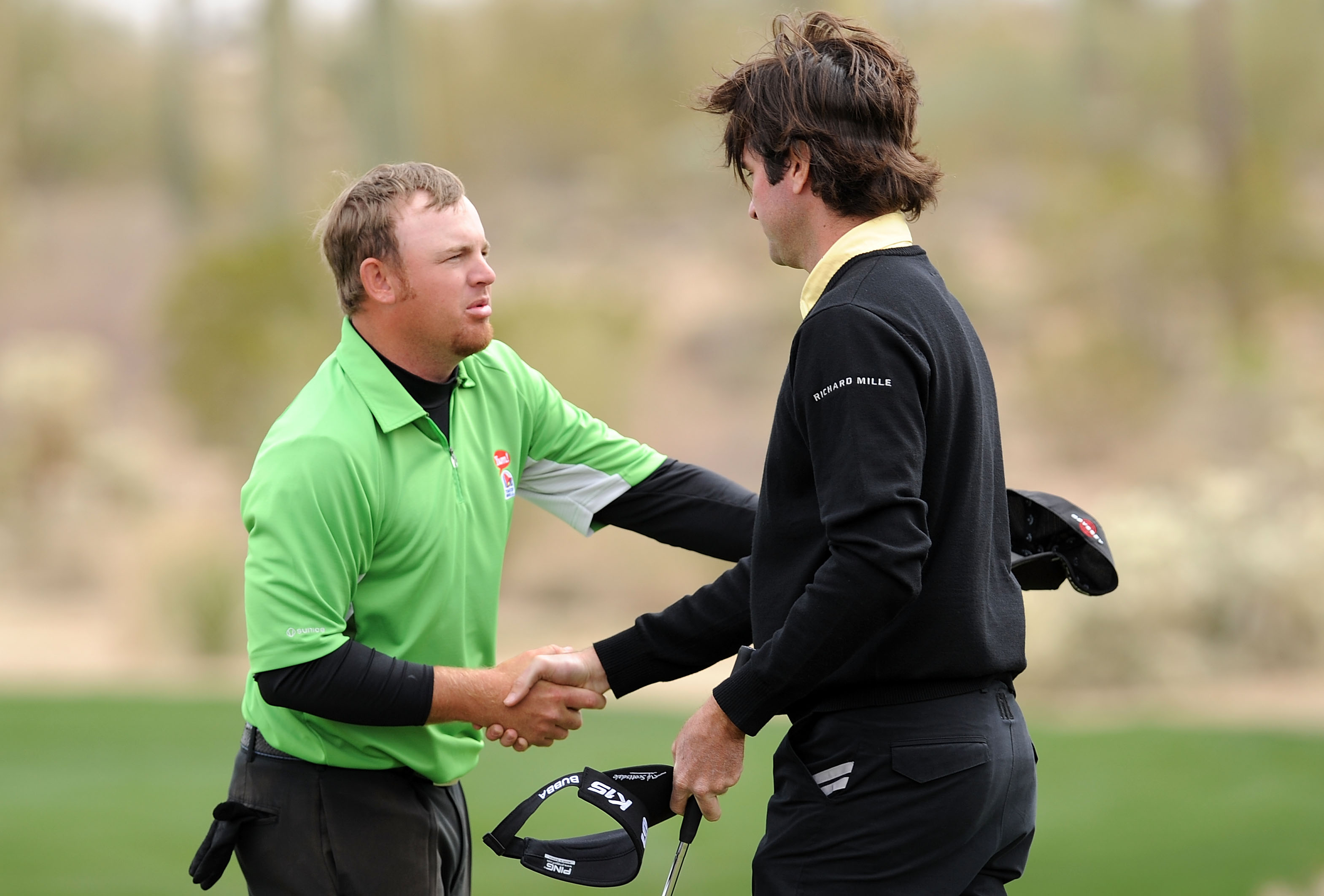 MARANA, AZ - FEBRUARY 26:  Bubba Watson shakes hands with J.B. Holmes on the first playoff hole during the quarterfinal round of the Accenture Match Play Championship at the Ritz-Carlton Golf Club on February 26, 2011 in Marana, Arizona.  (Photo by Stuart