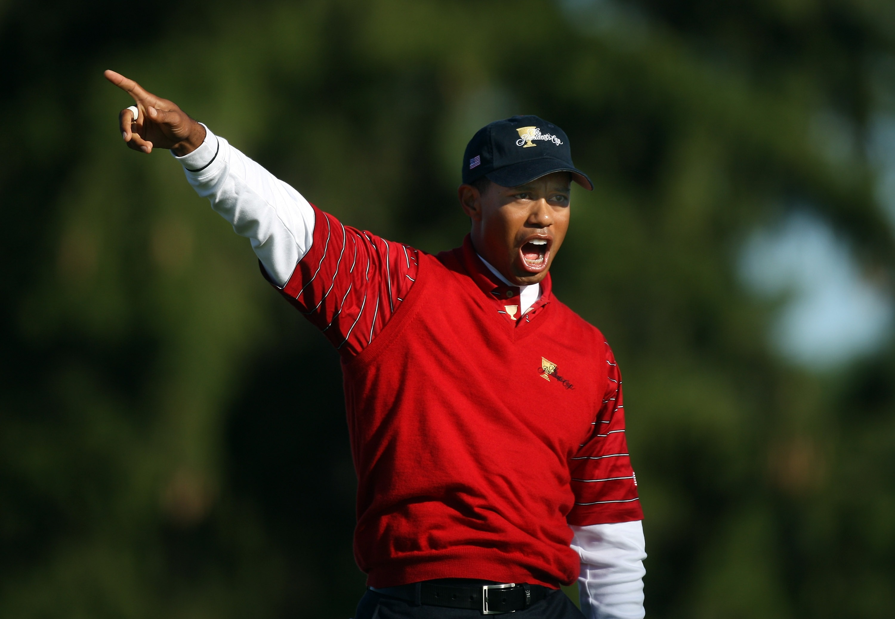 MONTREAL - SEPTEMBER 29:  Tiger Woods of the U.S. Team shouts 'fore' as he hits his tee shot to the ninth hole during the third day morning foursome matches at the Presidents Cup at Royal Montreal Golf Club September 29, 2007 in Montreal, Quebec, Canada.