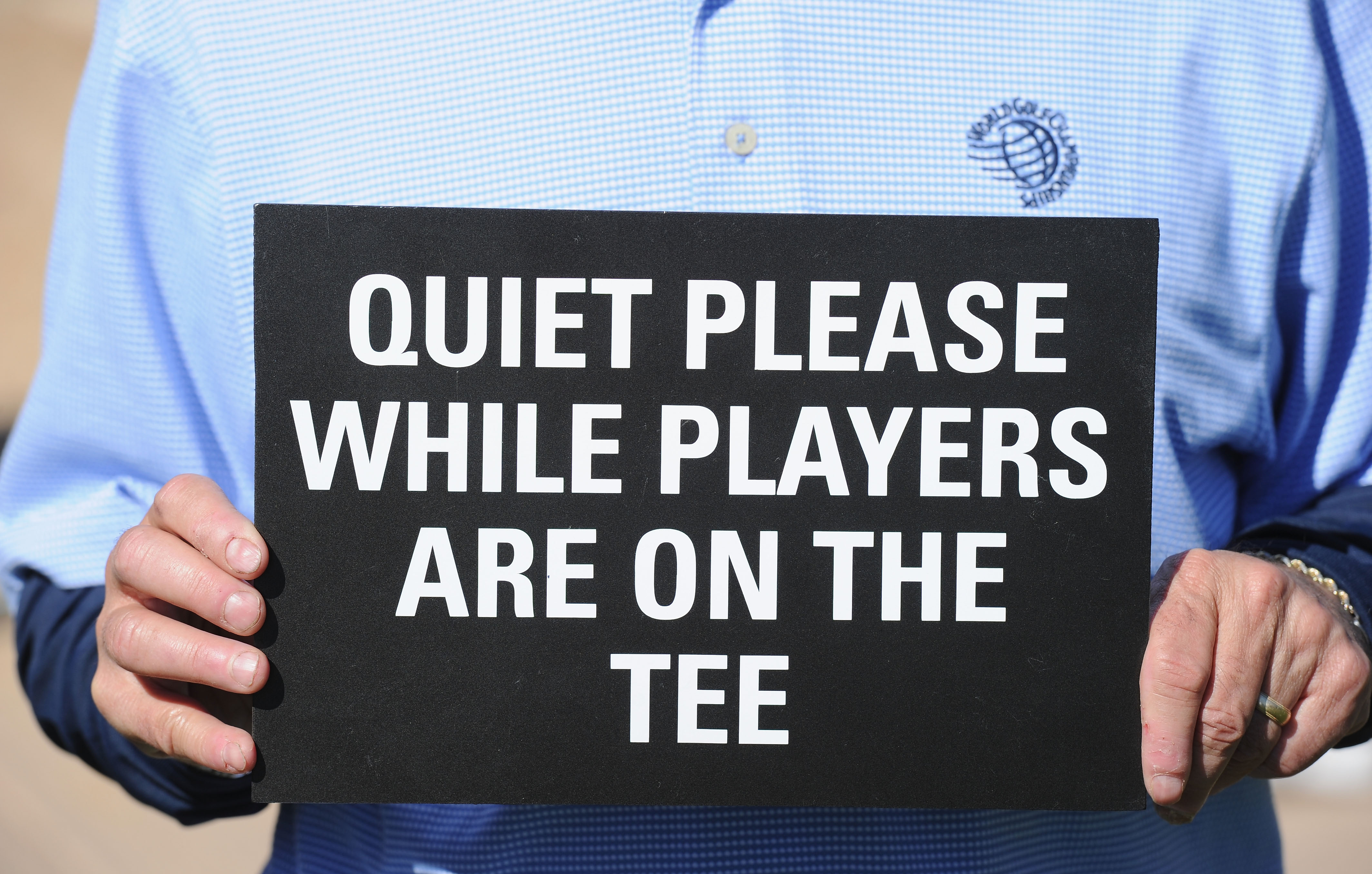 MARANA, AZ - FEBRUARY 24:  A marshall holds a quiet please sign during the second round of the Accenture Match Play Championship at the Ritz-Carlton Golf Club on February 24, 2011 in Marana, Arizona.  (Photo by Stuart Franklin/Getty Images)