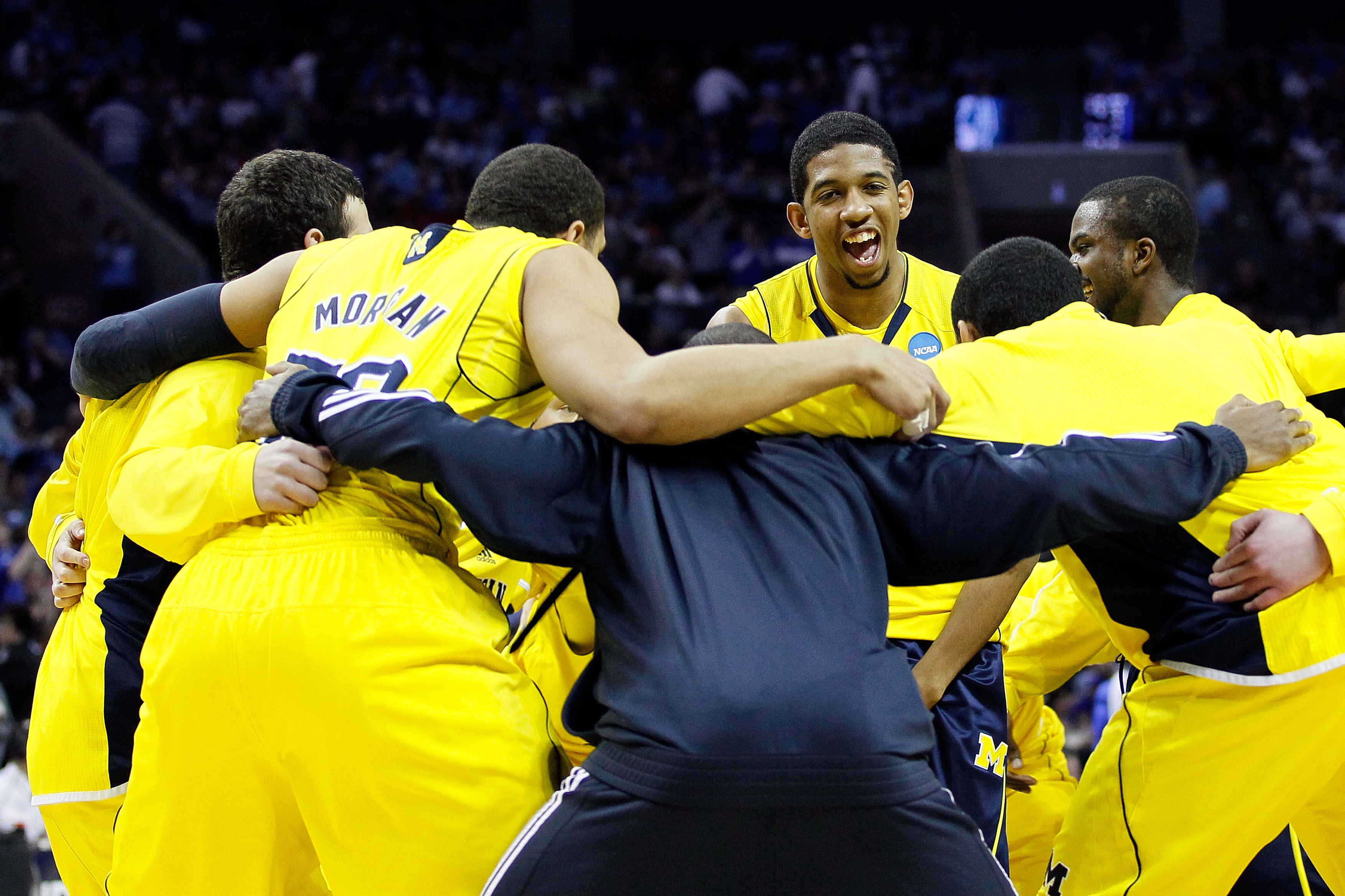 CHARLOTTE, NC - MARCH 20:  Darius Morris #4 of the Michigan Wolverines smiles as the Wolverines huddle before taking on the Duke Blue Devils during the third round of the 2011 NCAA men's basketball tournament at Time Warner Cable Arena on March 20, 2011 i
