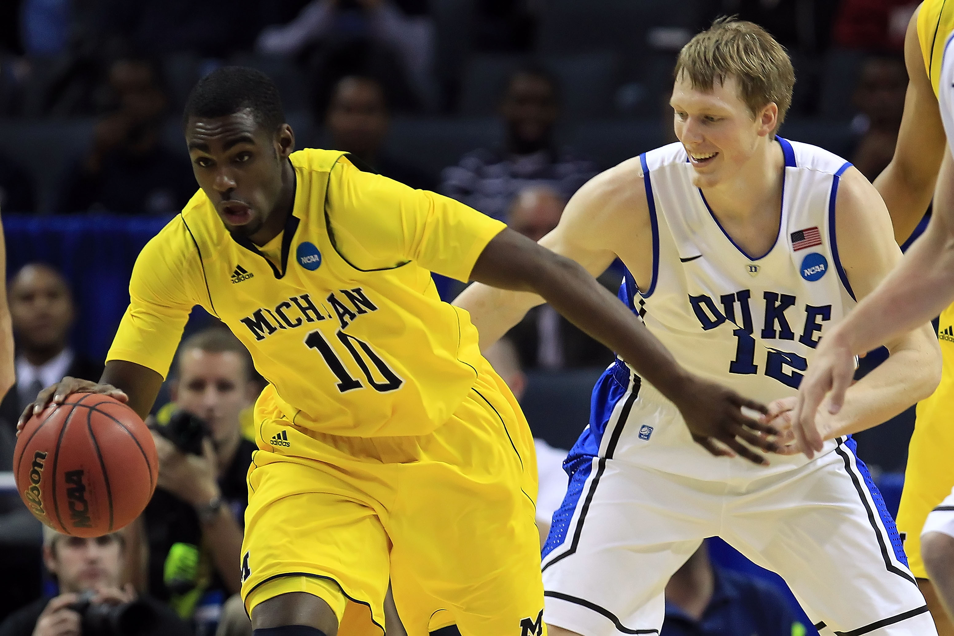 CHARLOTTE, NC - MARCH 20:  Tim Hardaway Jr. #10 of the Michigan Wolverines moves the ball against Kyle Singler #12 of the Duke Blue Devils in the first half during the third round of the 2011 NCAA men's basketball tournament at Time Warner Cable Arena on