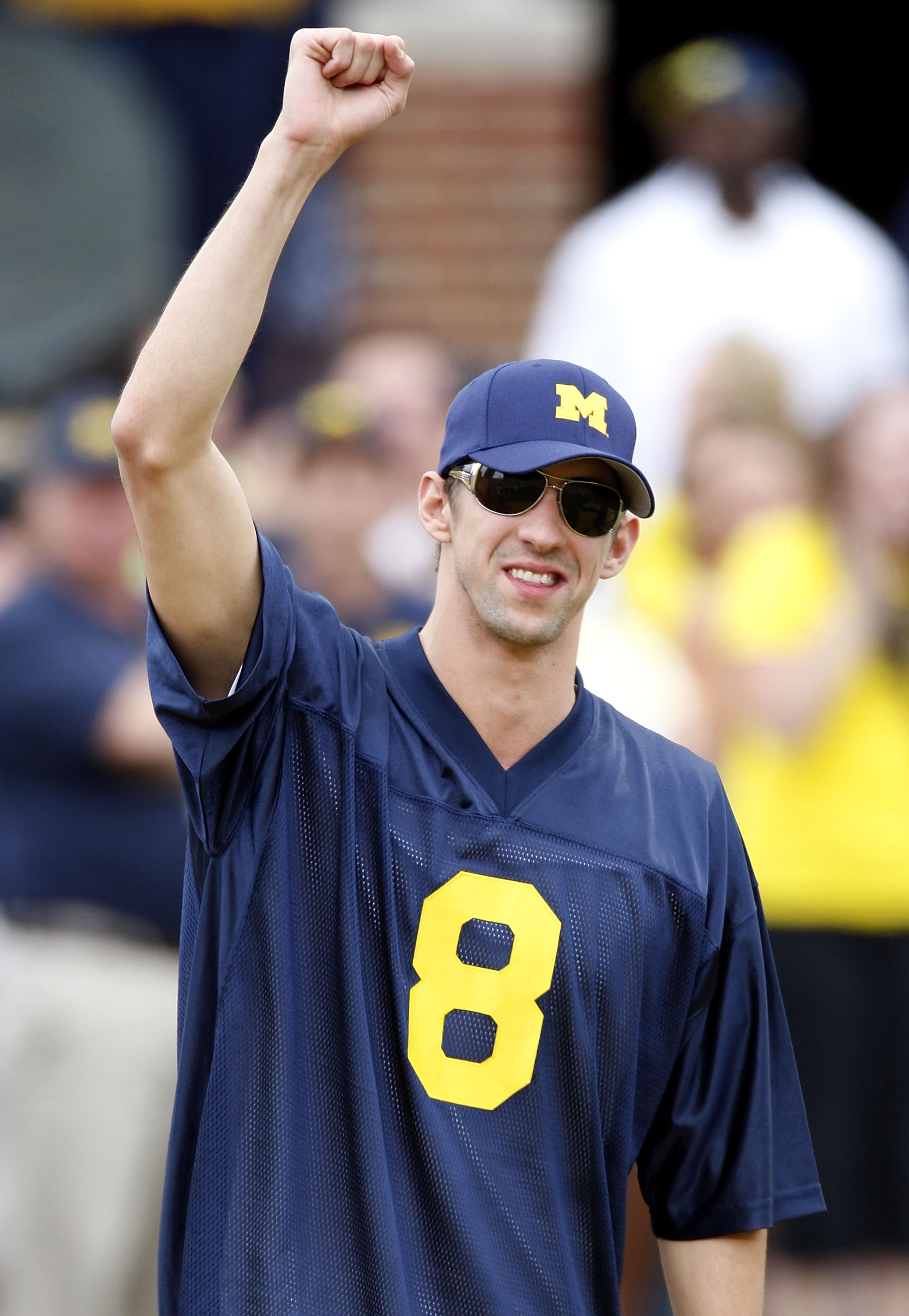 ANN ARBOR, MI - SEPTEMBER 27: 2008 Olympic gold medal winner Michael Phelps is introduced prior to the game between the Wisconsin Badgers and the Michigan Wolverines on September 27, 2008 at Michigan Stadium in Ann Arbor, Michigan. (Photo by Gregory Shamu