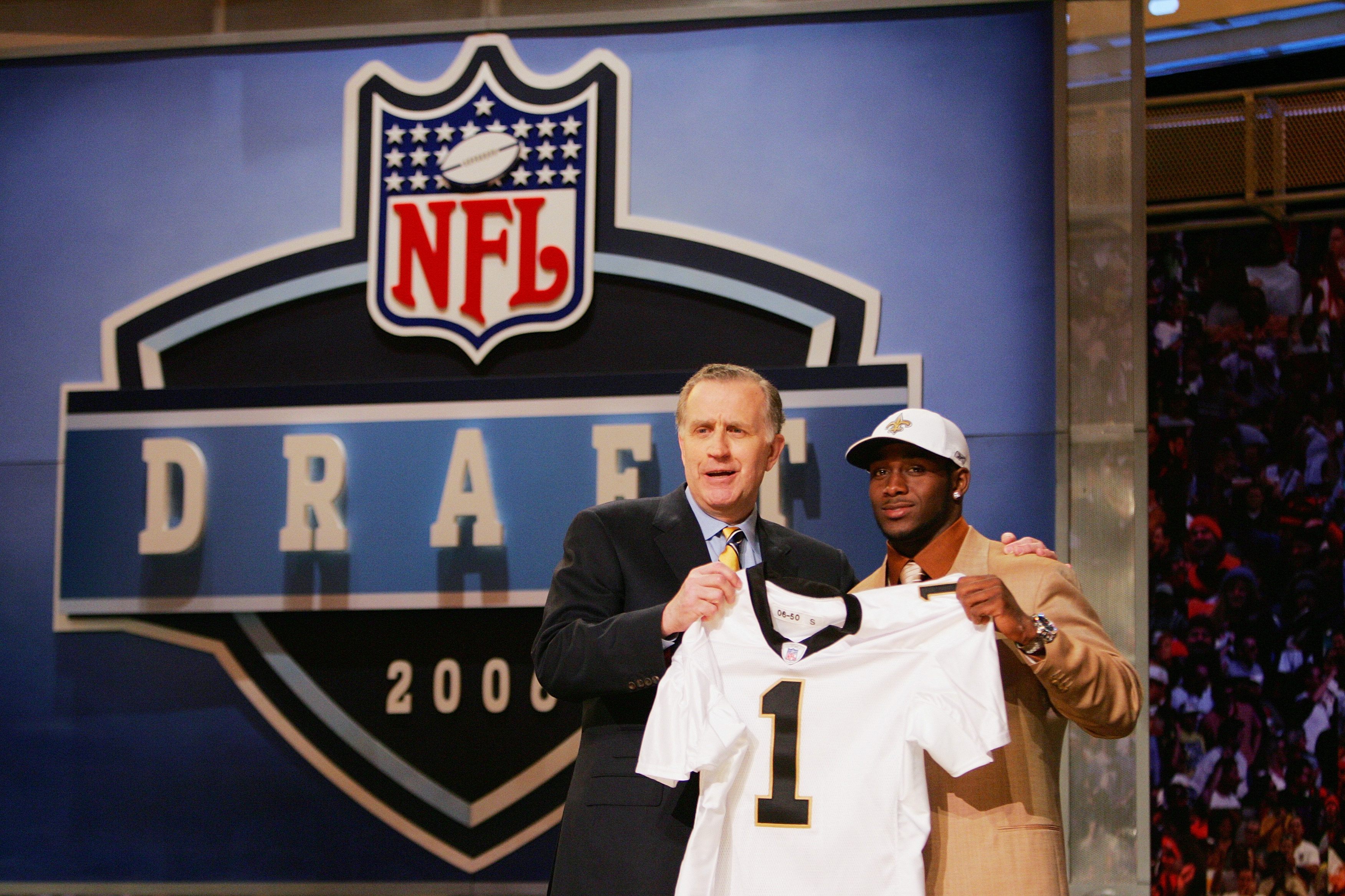 NEW YORK - APRIL 29:  Commissioner Paul Tagliabue and Reggie Bush pose for a photo after Bush was drafted by the New Orleans Saints during the 2006 NFL Draft on April 29, 2006 at Radio City Music Hall in New York, New York. (Photo by Chris Trotman/Getty I