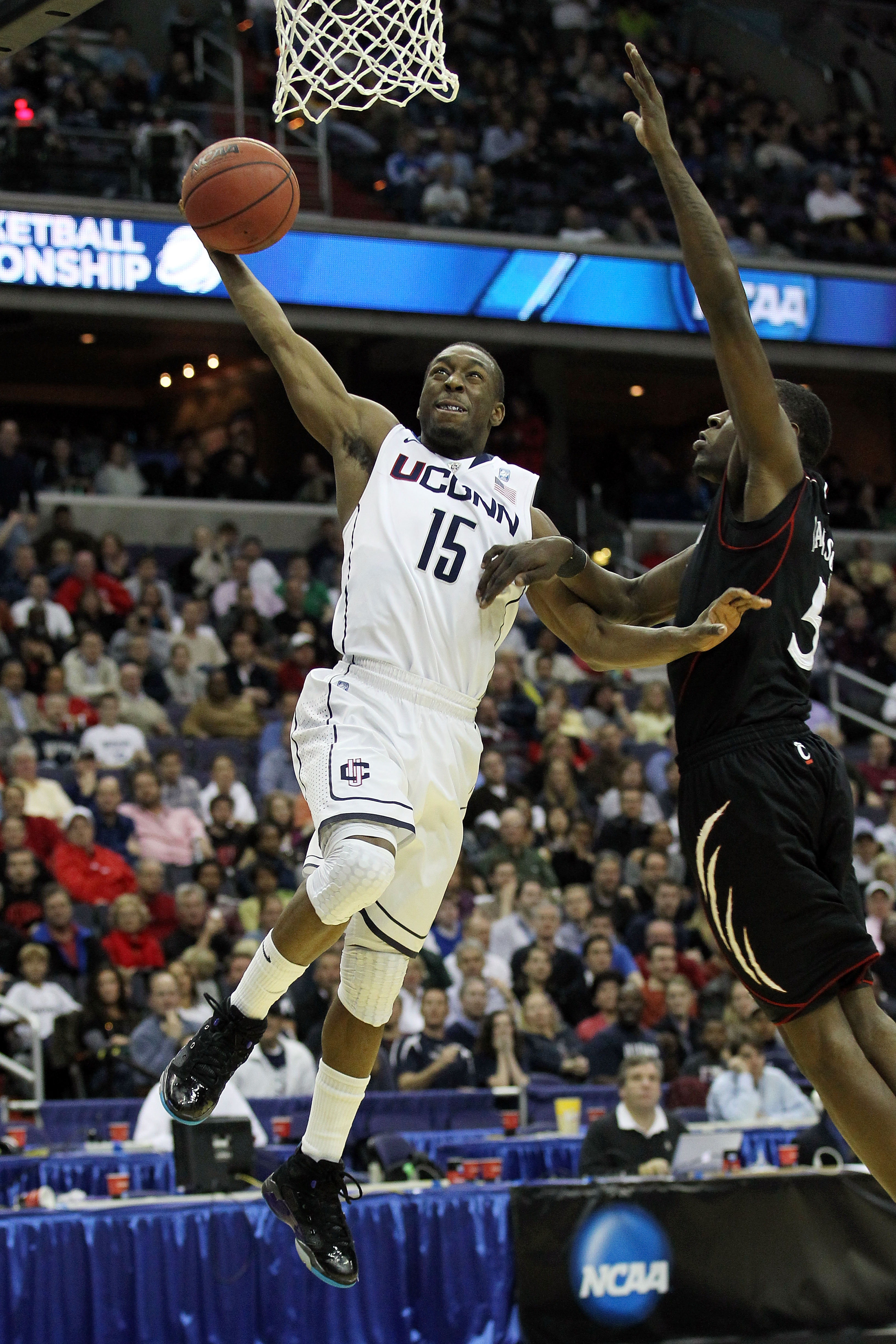 WASHINGTON - MARCH 19:  Kemba Walker #15 of the Connecticut Huskies goes in for a layup against the Cincinnati Bearcats during the third round of the 2011 NCAA men's basketball tournament at Verizon Center on March 19, 2011 in Washington, DC.  (Photo by N