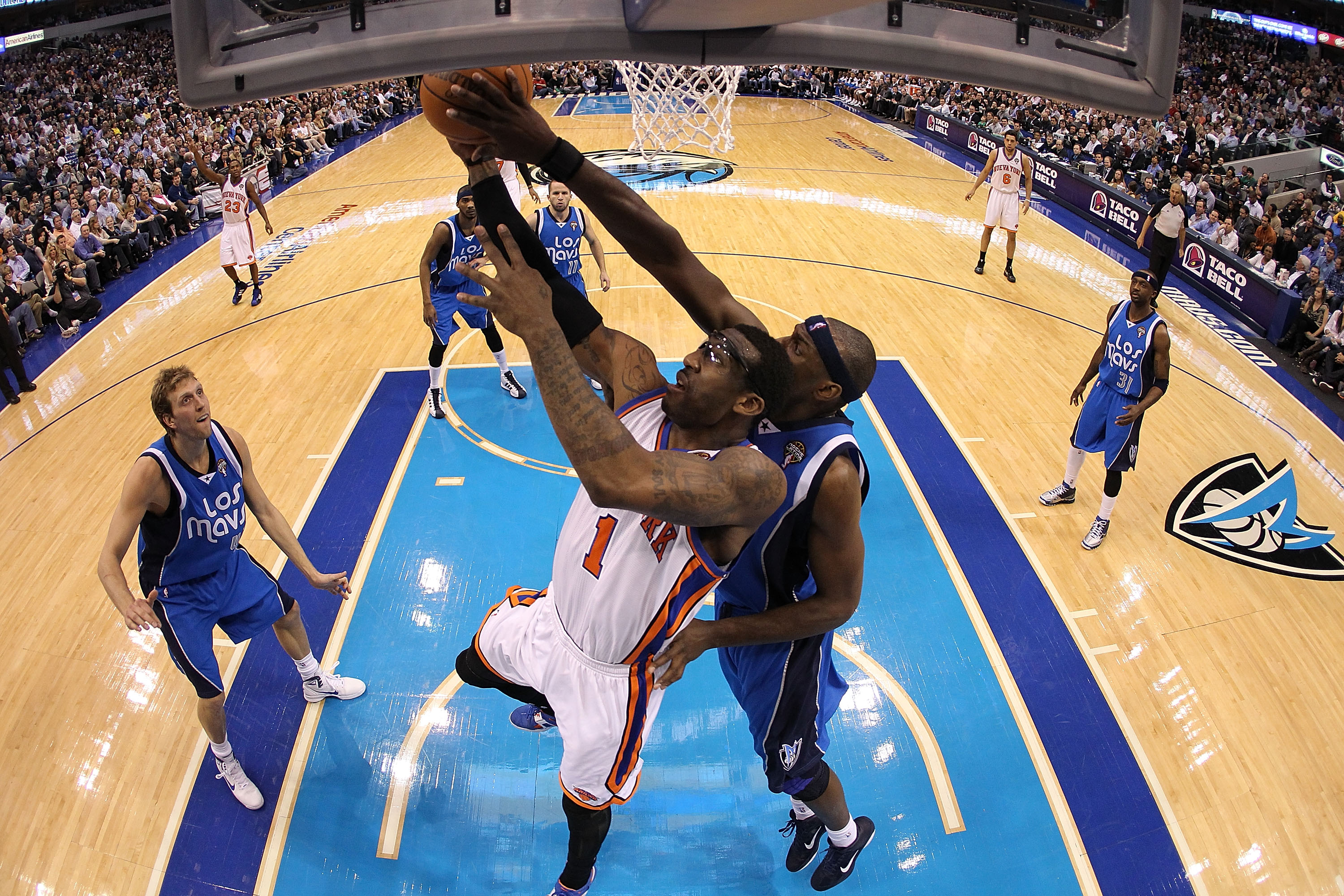 TX - MARCH 10:  Amar'e Stoudemire #1 of the New York Knicks is rejected by Brendan Haywood #33 of the Dallas Mavericks at American Airlines Center on March 10, 2011 in Dallas, Texas.  NOTE TO USER: User expressly acknowledges and agrees that, by downloadi