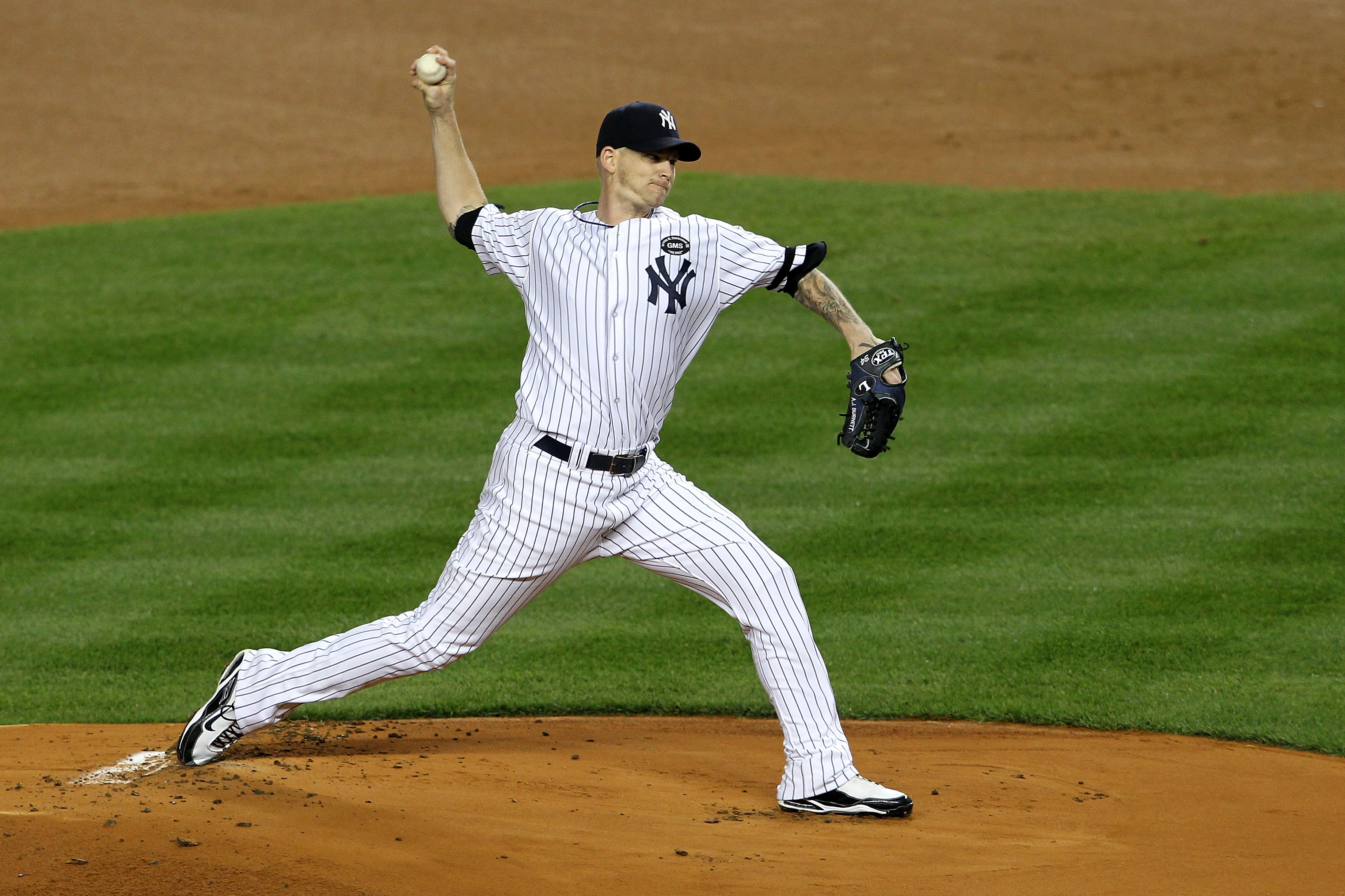 NEW YORK - OCTOBER 19:  A.J. Burnett #34 of the New York Yankees pitches against the Texas Rangers in Game Four of the ALCS during the 2010 MLB Playoffs at Yankee Stadium on October 19, 2010 in the Bronx borough of New York City. The Rangers won 10-3.  (P