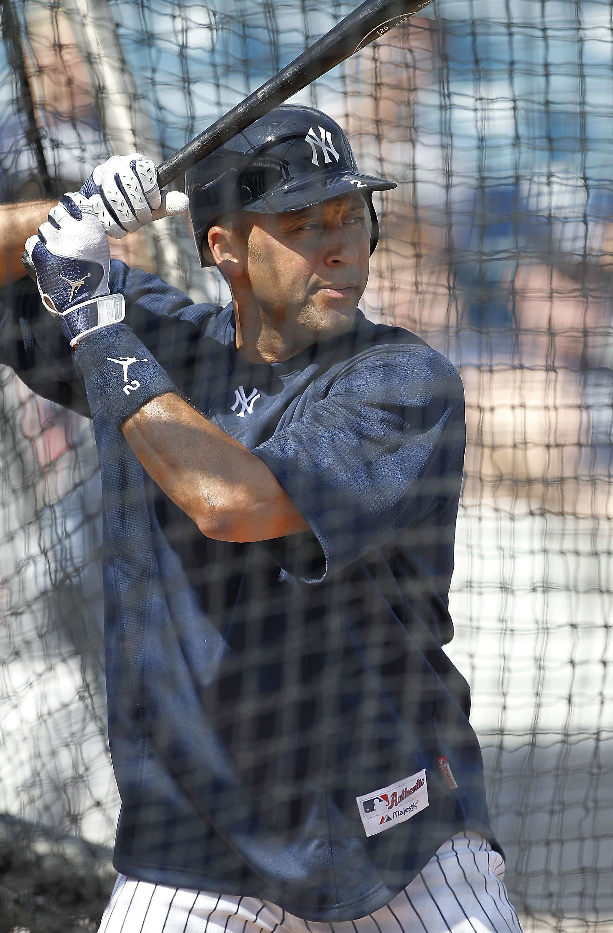 TAMPA, FL - FEBRUARY 20:  Derek Jeter #2 of the New York Yankees takes batting practice during the first full team workout of Spring Training on February 20, 2011 at the George M. Steinbrenner Field in Tampa, Florida.  (Photo by Leon Halip/Getty Images)