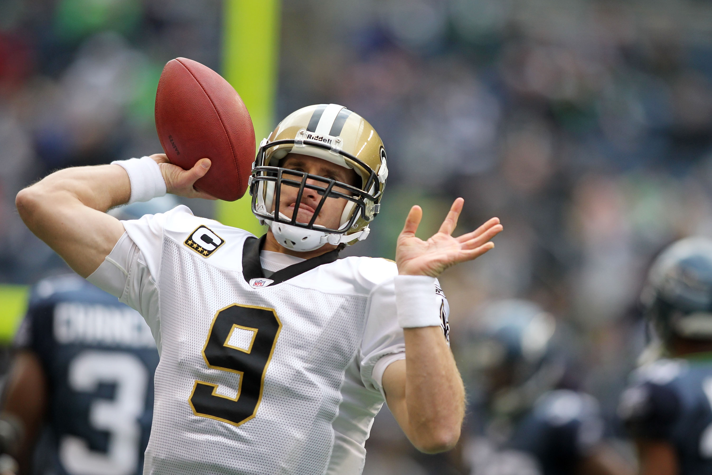 SEATTLE, WA - JANUARY 08:  Quarterback Drew Brees #9 of the New Orleans Saints throws the ball against the Seattle Seahawks during the 2011 NFC wild-card playoff game at Qwest Field on January 8, 2011 in Seattle, Washington.  (Photo by Jonathan Ferrey/Get
