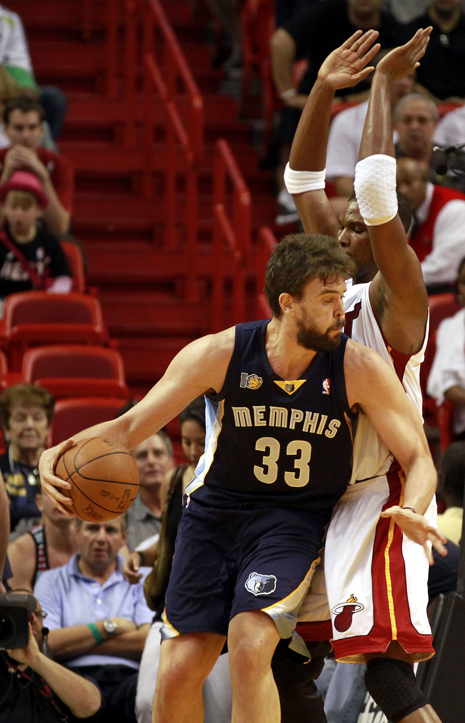MIAMI - MARCH 12:  Forward Chris Bosh #1 of the Miami Heat defends against  Marc Gasol #33 of the Memphis Grizzlies at American Airlines Arena on March 12, 2011 in Miami, Florida. NOTE TO USER: User expressly acknowledges and agrees that, by downloading a