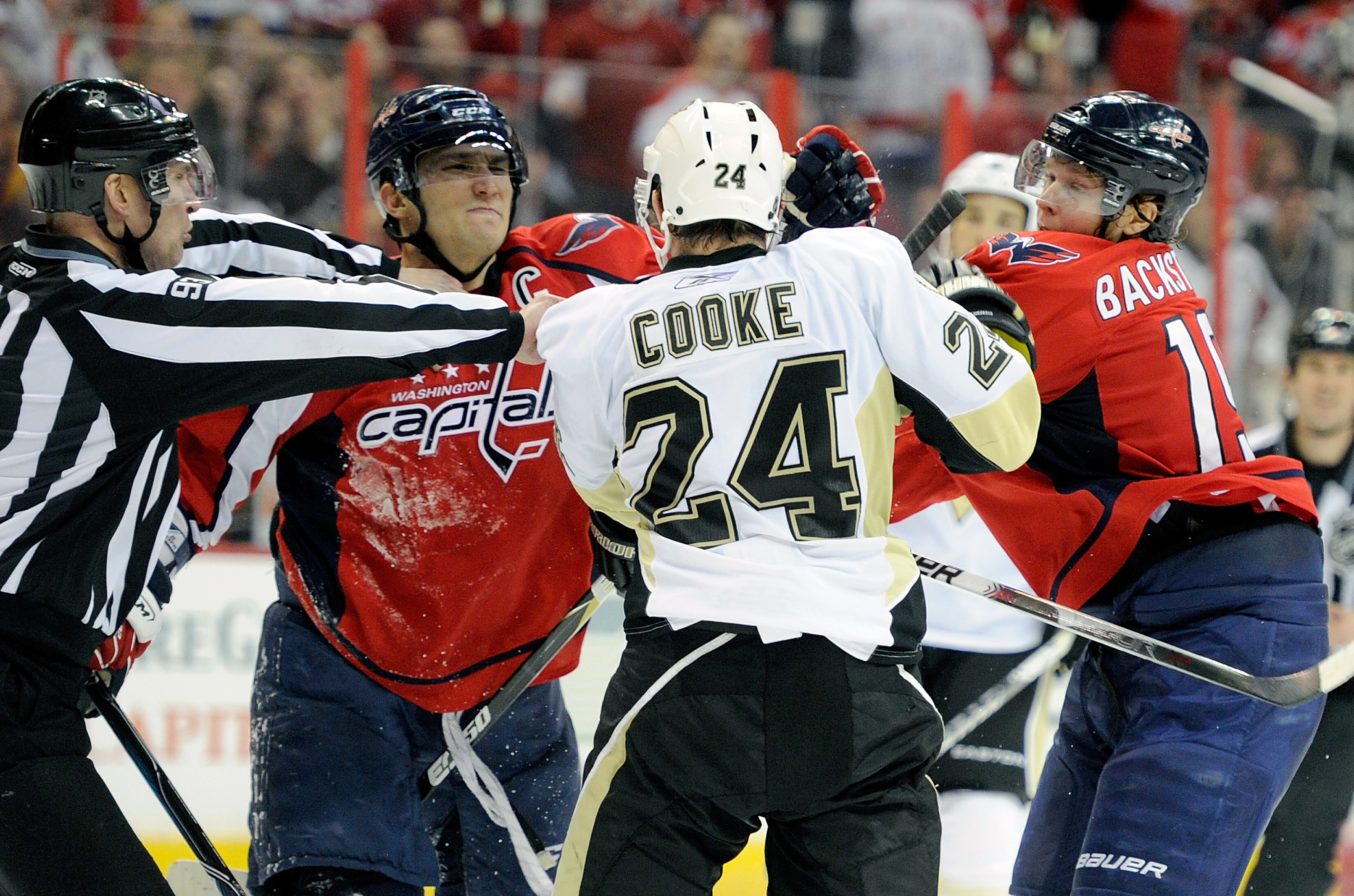WASHINGTON, DC - FEBRUARY 06:  Alex Ovechkin #8 and Nicklas Backstrom #19 of the Washington Capitals rough it up with Matt Cooke #24 of the Pittsburgh Penguins at the Verizon Center on February 6, 2011 in Washington, DC.  (Photo by Greg Fiume/Getty Images