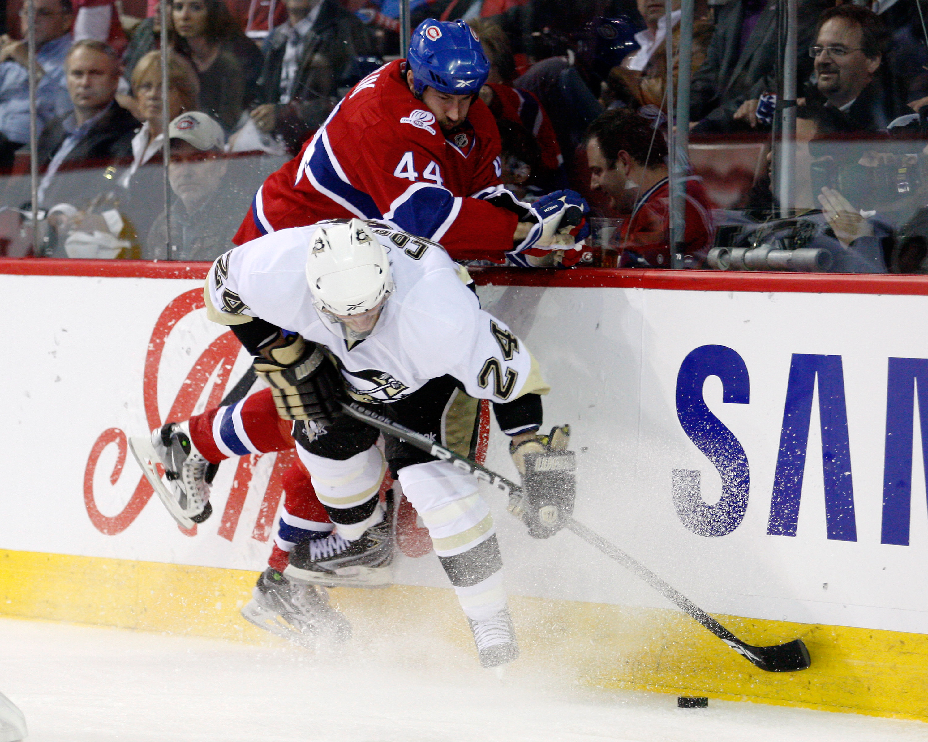 MONTREAL- MAY 10:  Roman Hamrlik #44 of the Montreal Canadiens body checks Matt Cooke #24 of the Pittsburgh Penguins in Game Six of the Eastern Conference Semifinals during the 2010 NHL Stanley Cup Playoffs at the Bell Centre on May 10, 2010 in Montreal,