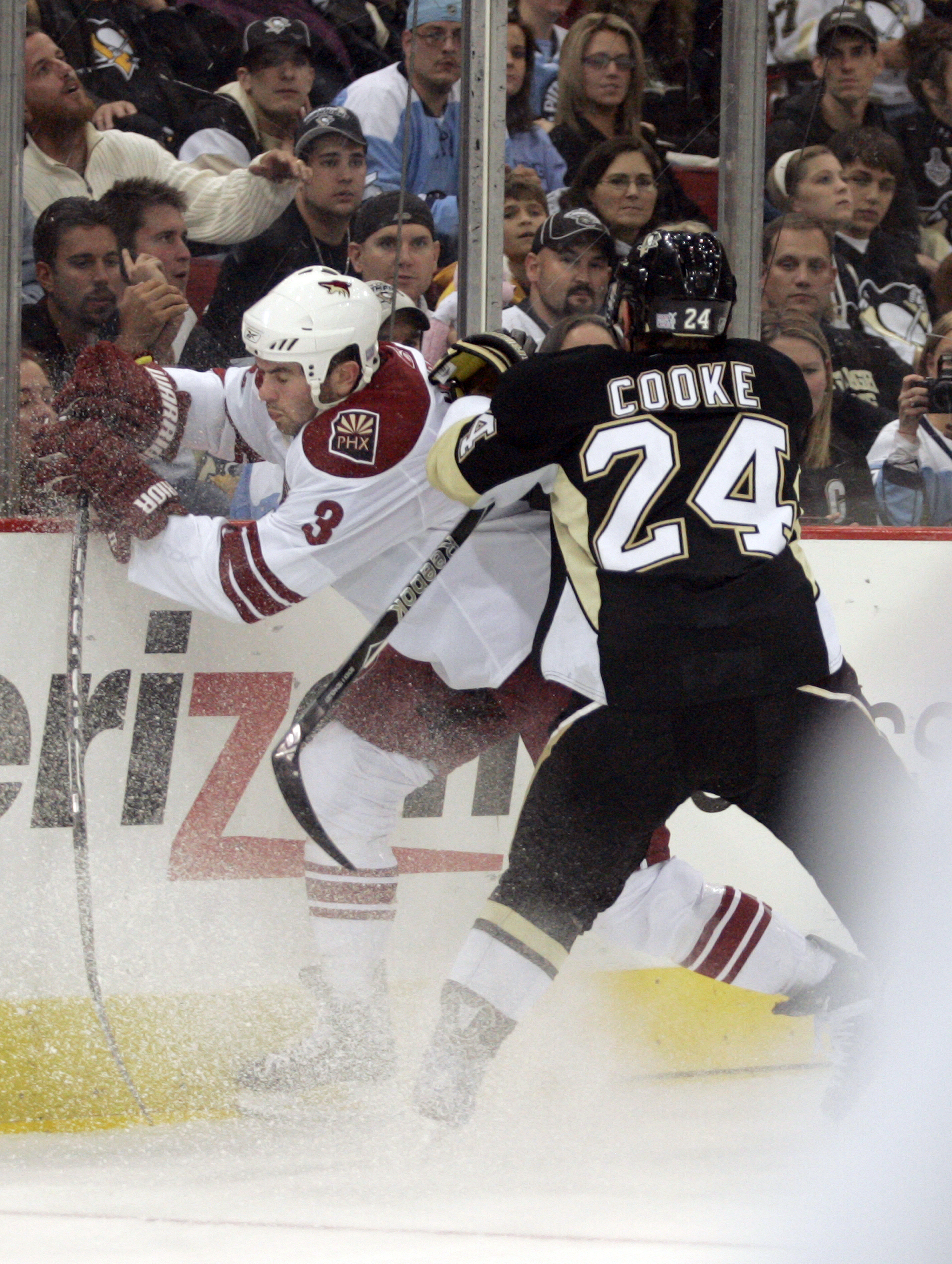 PITTSBURGH, PA - OCTOBER 07:  Matt Cooke #24 of the Pittsburgh Penguins checks Keith Yandle #3 of the Phoenix Coyotes in the first period at Mellon Arena on October 07, 2009 in Pittsburgh, Pennsylvania.  (Photo by Justin K. Aller/Getty Images)