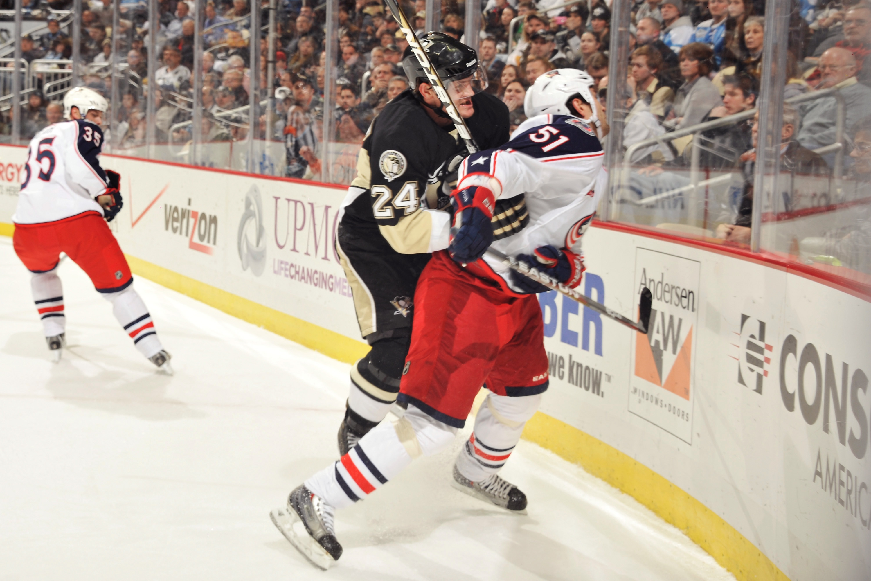PITTSBURGH, PA - FEBRUARY 8:  Matt Cooke #24 of the Pittsburgh Penguins checks Fedor Tyutin #51 of the Columbus Blue Jackets in the first period on February 8, 2011 at CONSOL Energy Center in Pittsburgh, Pennsylvania. Cooke was assessed a five-minute majo
