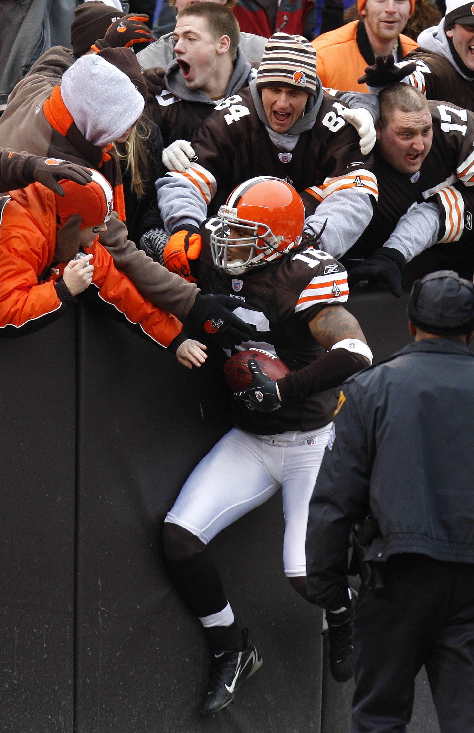 CLEVELAND - DECEMBER 30:  Joshua Cribbs #16 of the Cleveland Browns jumps into the stands to celebrate a first quarter punt return for a touchdown against the San Francisco 49ers on December 30, 2007 at Cleveland Browns Stadium in Cleveland, Ohio. Clevela