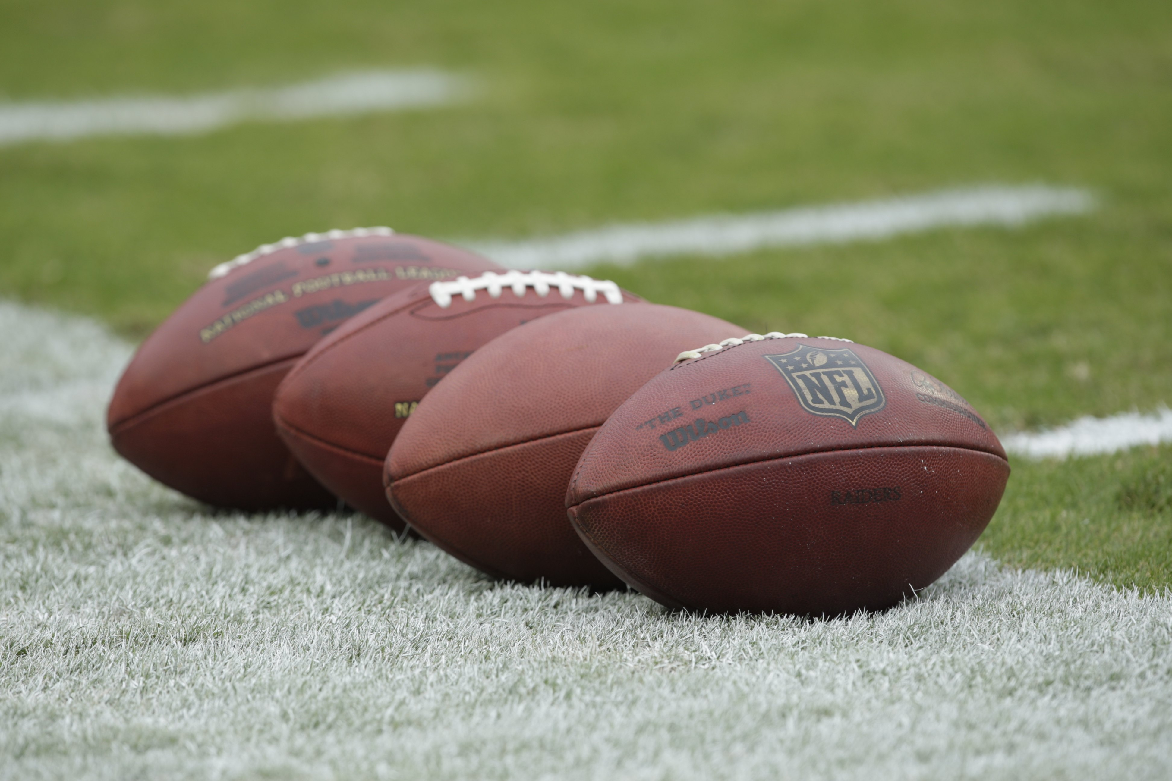 KANSAS CITY, MO - SEPTEMBER 20:  View of footballs on the field before the Oakland Raiders game against the Kansas City Chiefs at Arrowhead Stadium on September 20, 2009 in Kansas City, Missouri. (Photo by Jamie Squire/Getty Images)