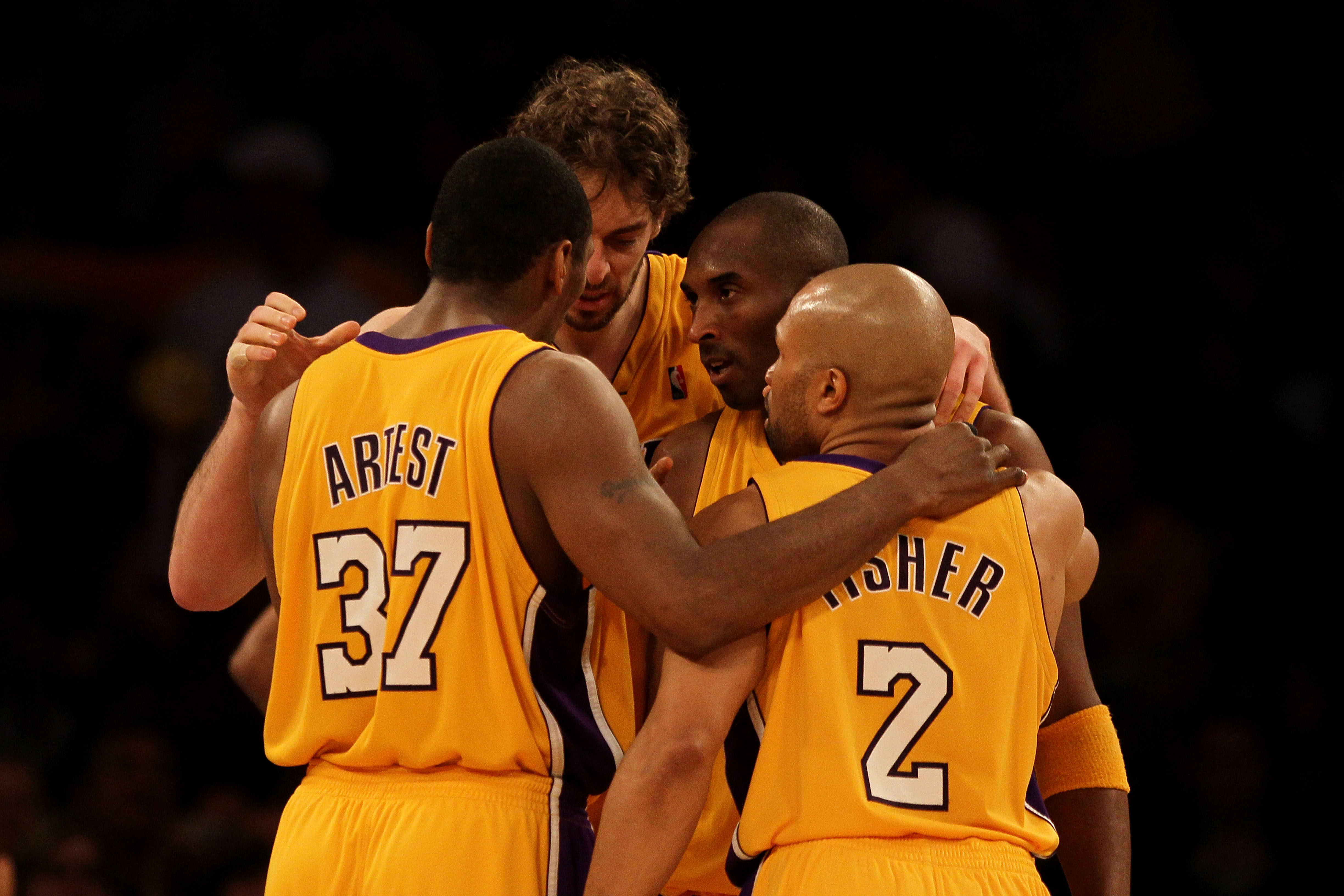 LOS ANGELES, CA - MAY 19:  (L-R) Ron Artest #37, Pau Gasol #16, Kobe Bryant #24 and Derek Fisher #2 of the Los Angeles Lakers huddle together in Game Two of the Western Conference Finals against the Phoenix Suns during the 2010 NBA Playoffs at Staples Cen