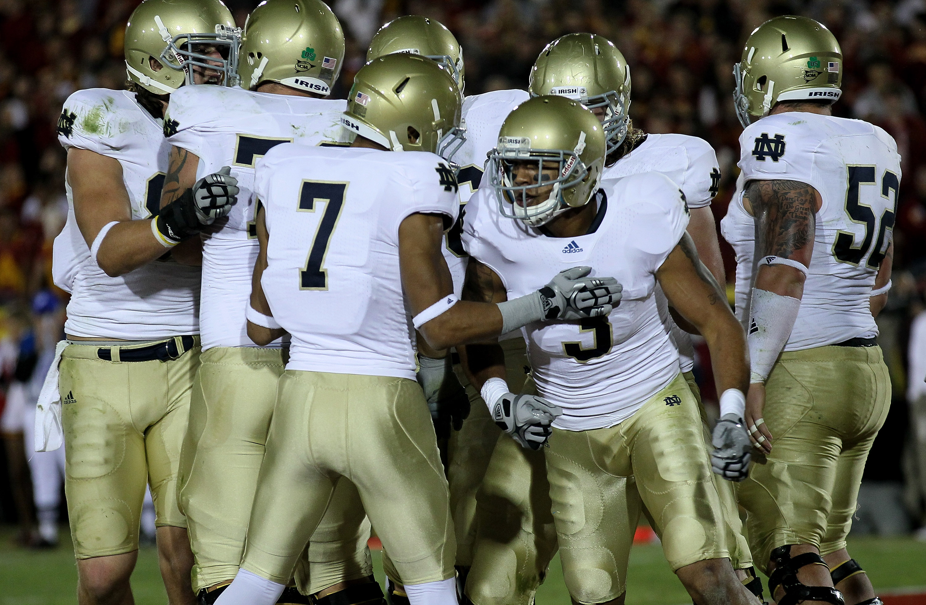 LOS ANGELES - NOVEMBER 27:  Wide receiver Michael Floyd #3 of the Notre Dame Fighting Irish celebrates with wide receiver T.J. Jones #7 after making a one yard touchdown catch against the USC Trojans at the Los Angeles Memorial Coliseum on November 27, 20