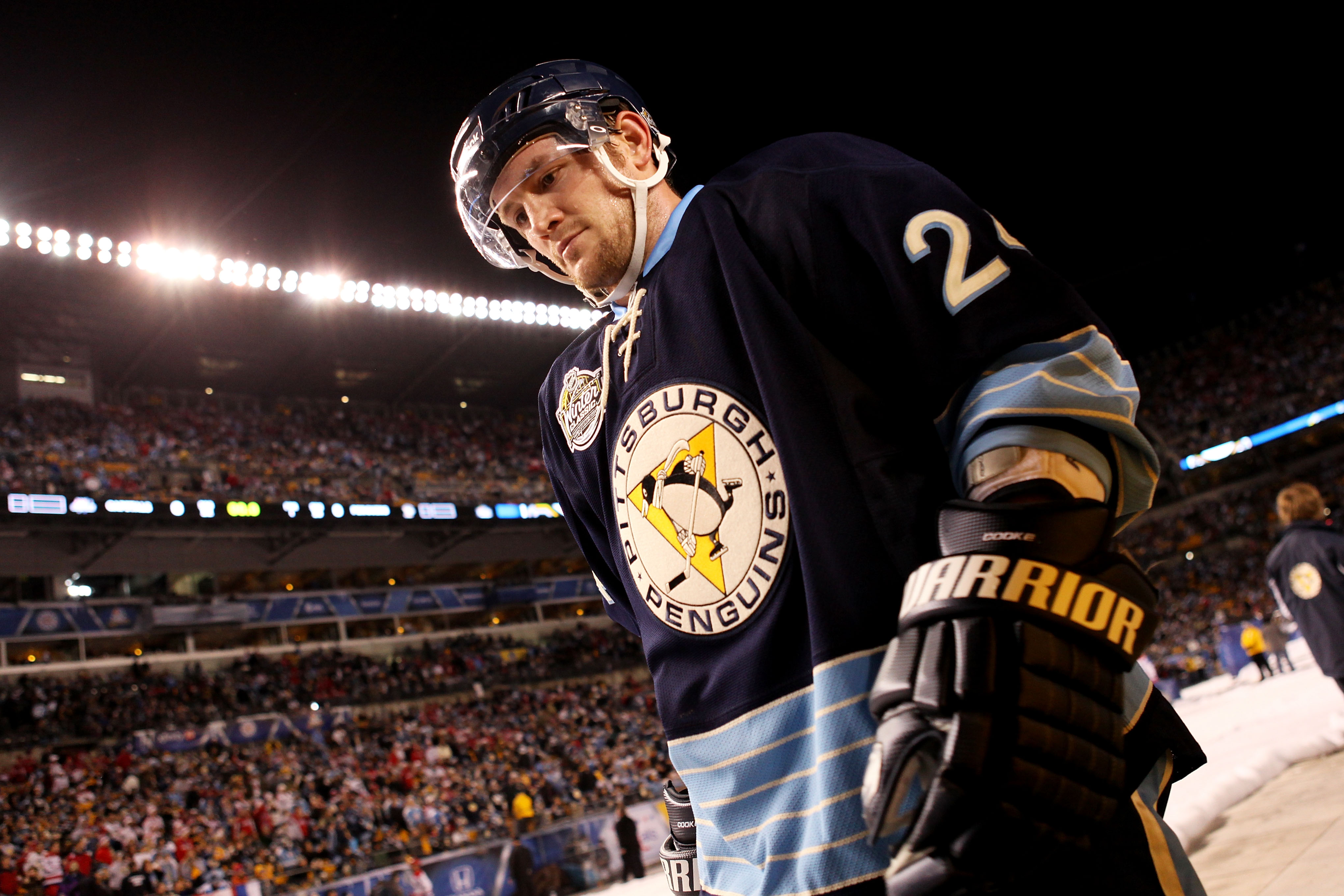 PITTSBURGH, PA - JANUARY 01:  Matt Cooke #24 of the Pittsburgh Penguins walks to the ice before playing against the Washington Capitals during the 2011 NHL Bridgestone Winter Classic at Heinz Field on January 1, 2011 in Pittsburgh, Pennsylvania. Washingto
