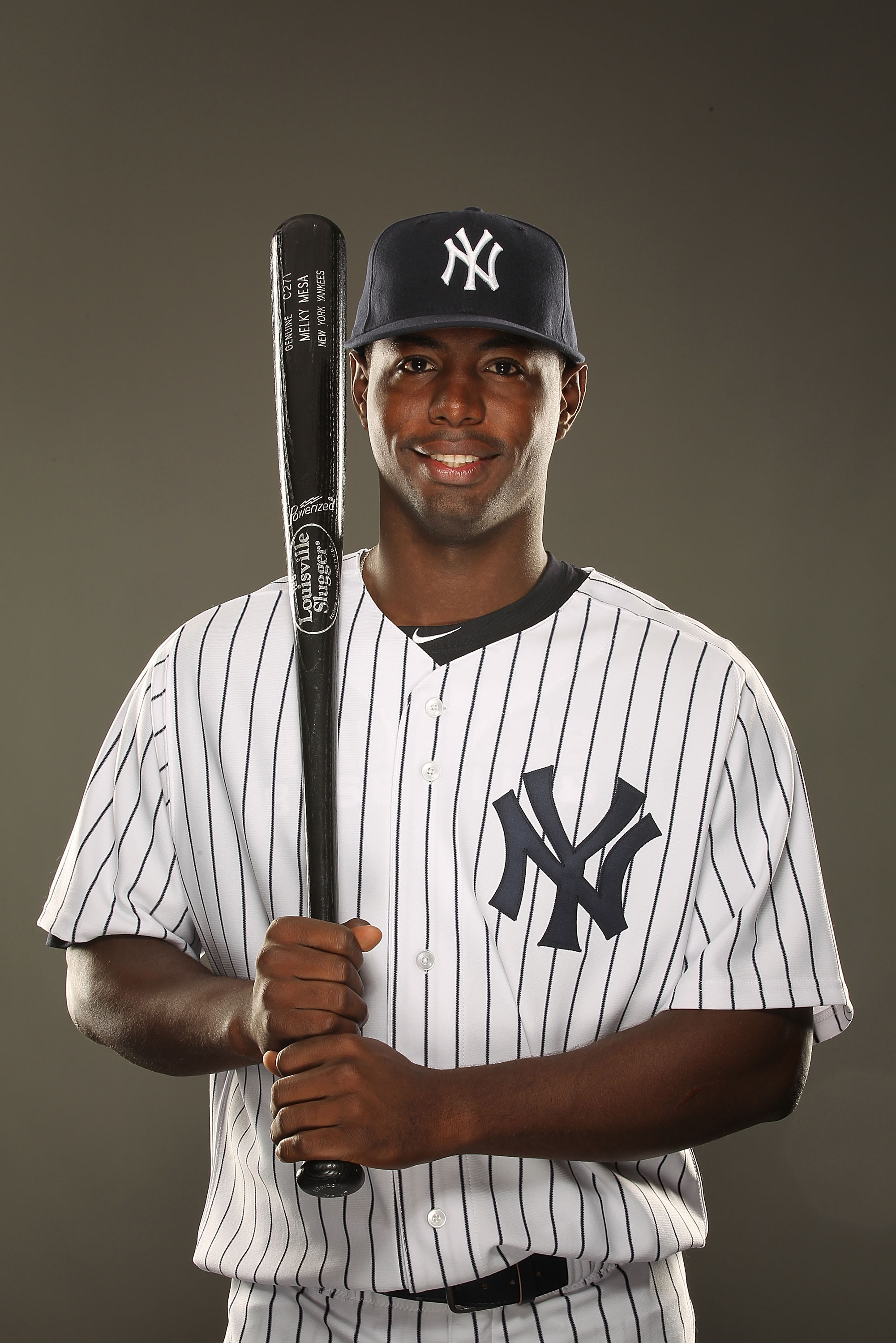 TAMPA, FL - FEBRUARY 23:  Melky Mesa #77 of the New York Yankees poses for a portrait on Photo Day at George M. Steinbrenner Field on February 23, 2011 in Tampa, Florida.  (Photo by Al Bello/Getty Images)