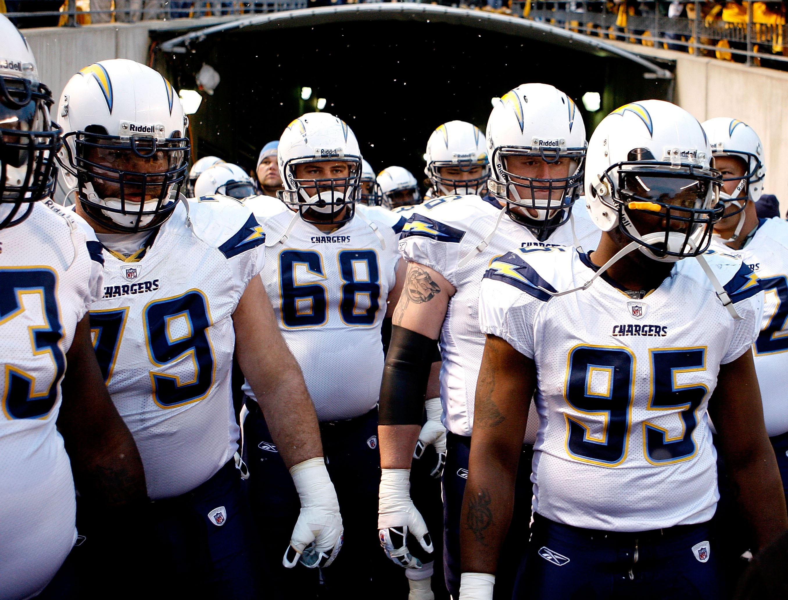 PITTSBURGH - JANUARY 11:  Mike Goff #79, Kris Dielman #68, Jeromey Clary #66 and Shaun Phillips #95 of the San Diego Chargers wait in the tunnel before taking the field against the Pittsburgh Steelers during their AFC Divisional Playoff Game on January 11