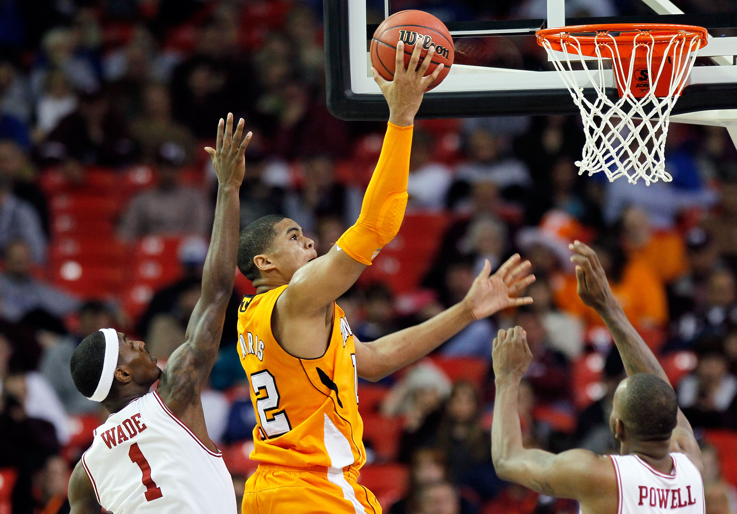 ATLANTA, GA - MARCH 10:  Tobias Harris #12 of the Tennessee Volunteers shoots over Marshawn Powell #33 and Mardracus Wade #1 of the Arkansas Razorbacks during the first round of the SEC Men's Basketball Tournament at the Georgia Dome on March 10, 2011 in