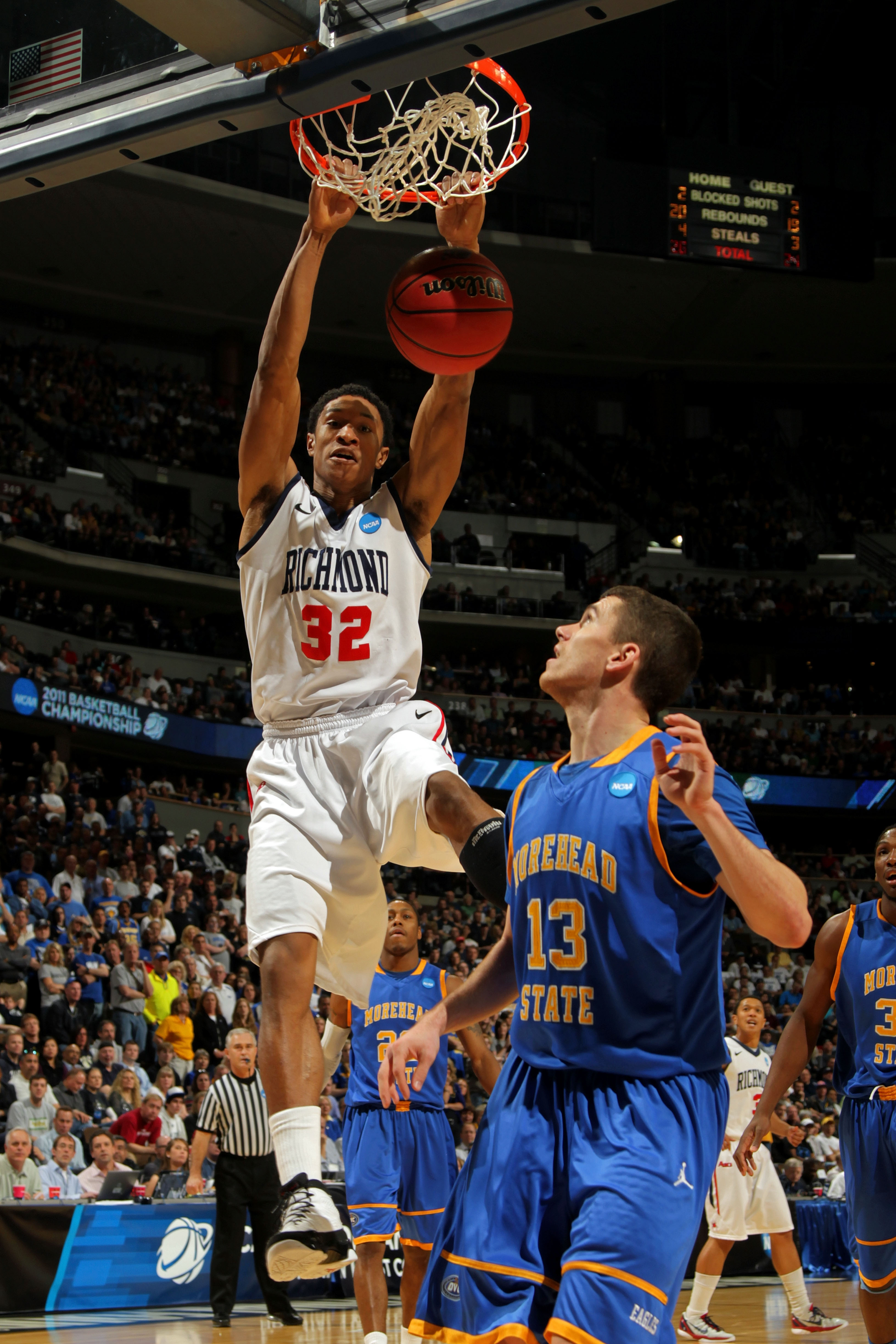 DENVER, CO - MARCH 19:  Justin Harper #32 of the Richmond Spiders dunks the ball against Ty Proffitt #13 of the Morehead State Eagles during the third round of the 2011 NCAA men's basketball tournament at Pepsi Center on March 19, 2011 in Denver, Colorado