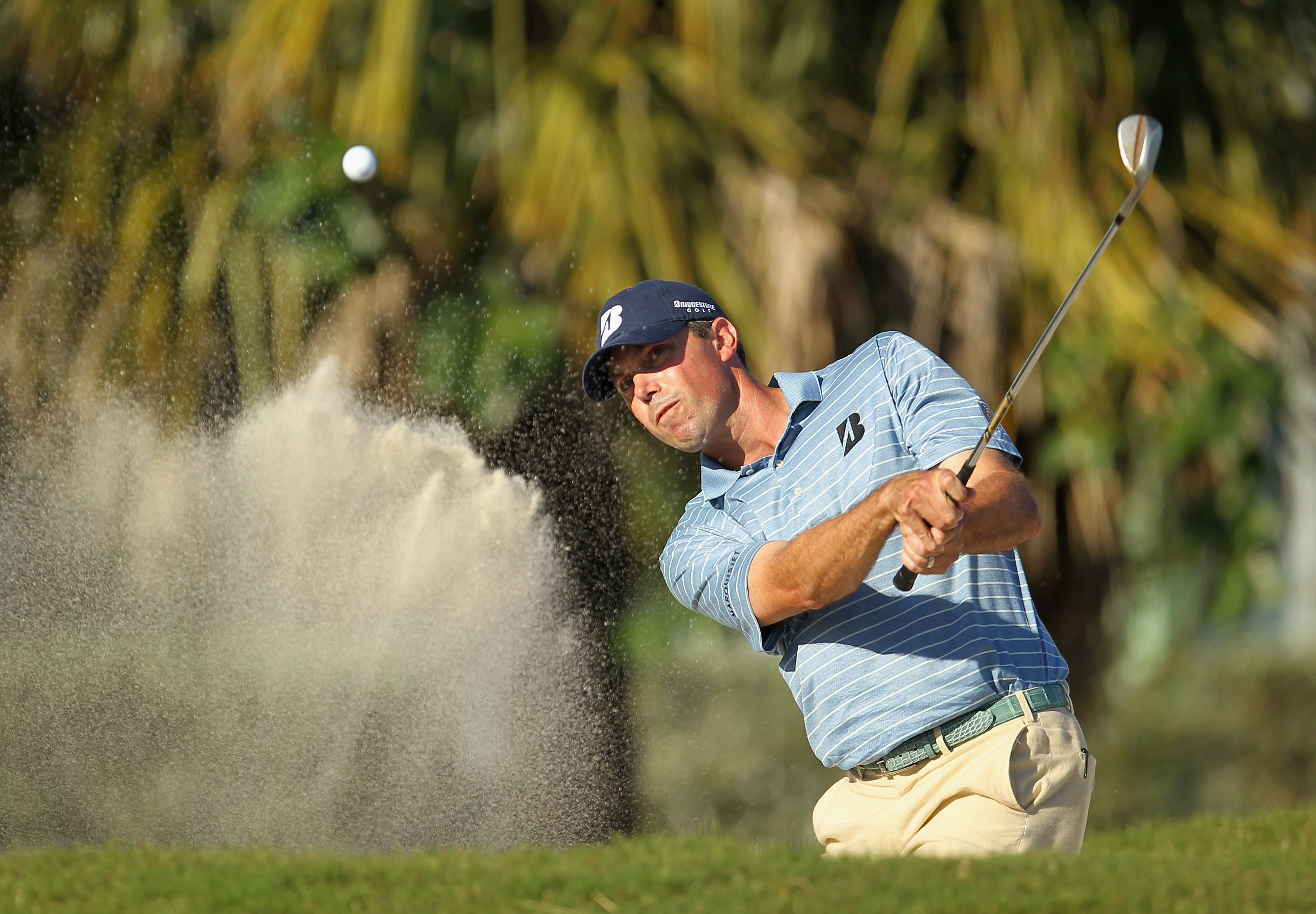 DORAL, FL - MARCH 13:  Matt Kuchar hits a bunker shot on the 13th hole during the final round of the 2011 WGC- Cadillac Championship at the TPC Blue Monster at the Doral Golf Resort and Spa on March 13, 2011 in Doral, Florida.  (Photo by Mike Ehrmann/Gett